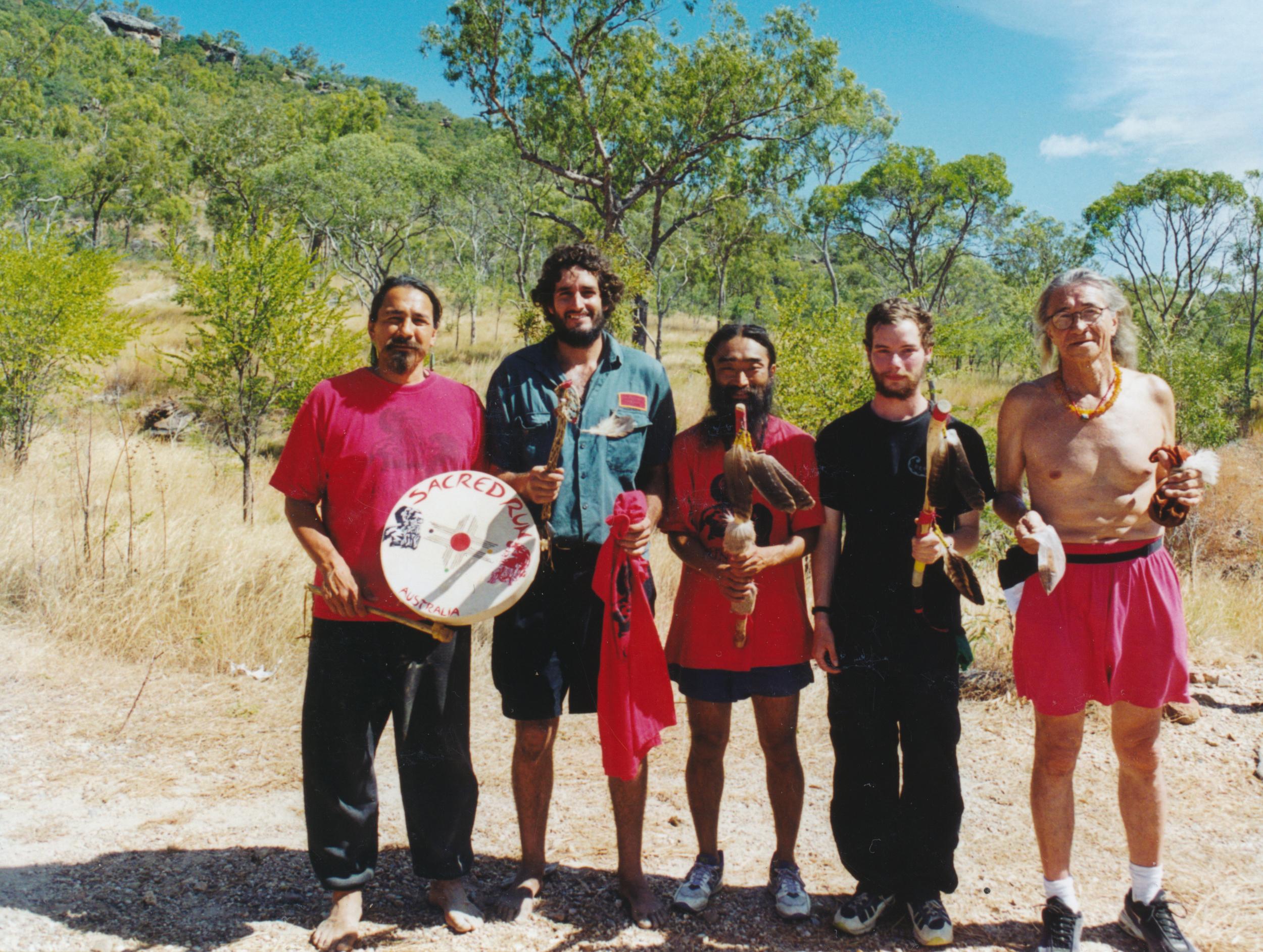Gorran Gilkerson (2nd left) at Split Rock Aboriginal art area near Laura, Queensland, Australia