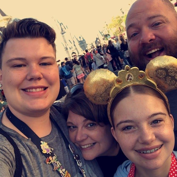 The Slavik's at Disney with their 2 biological children before they started fostering.