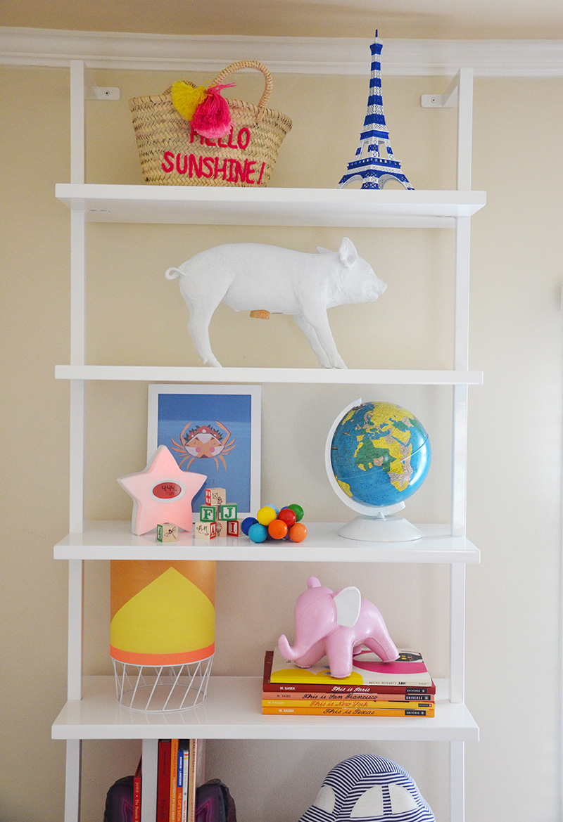 Wall hugging shelves offer a place for June to store vintage books, a modern lamp found by her parents on a weekend in Palm Springs, a piggy bank by artist Harry Allen found at Erin Martin's Napa showroom, a vintage globe lovingly restored by June's dad and other meaningful gifts and finds.