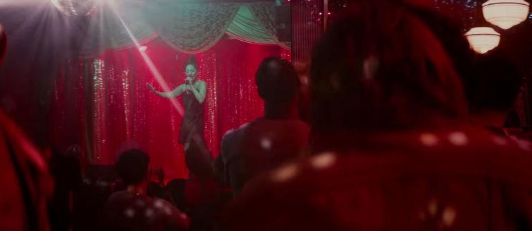 Ally performing  La Vie En Rose,  as seen from Jack's perspective.