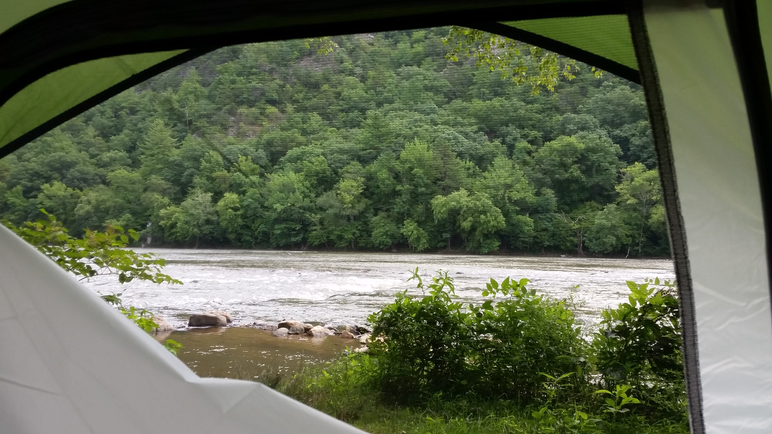 A tent with a view! Looking out on the French Broad River in Hot Springs, NC.
