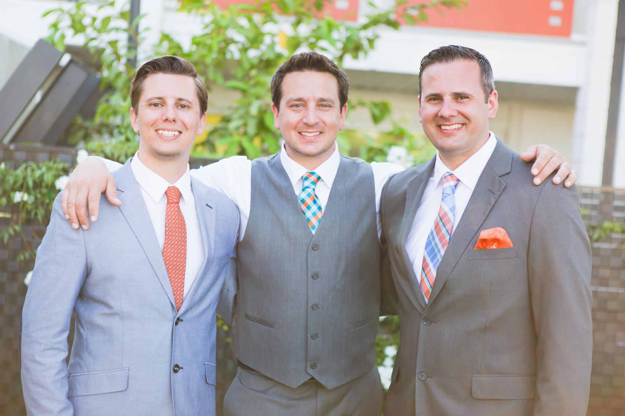 scottsdale-wedding-photographer-el-dorado-groom-brothers-smiling