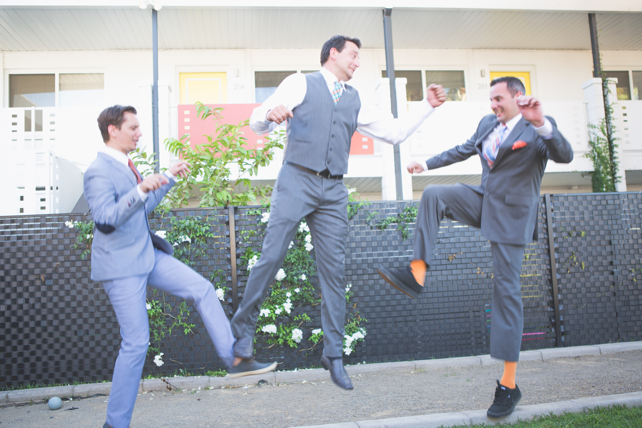 scottsdale-wedding-photographer-el-dorado-groom-brothers-play-fighting