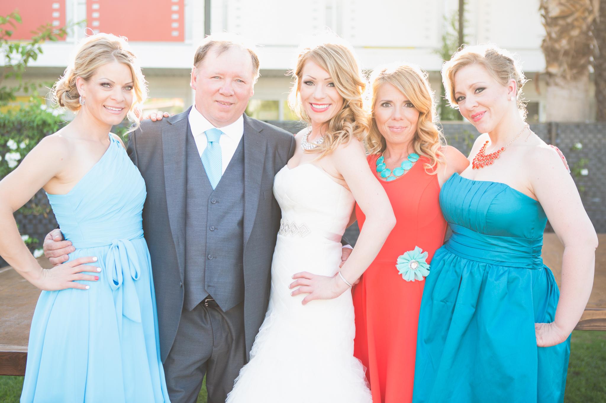 scottsdale-wedding-photographer-el-dorado-bride-sisters-father-colorful-backlight