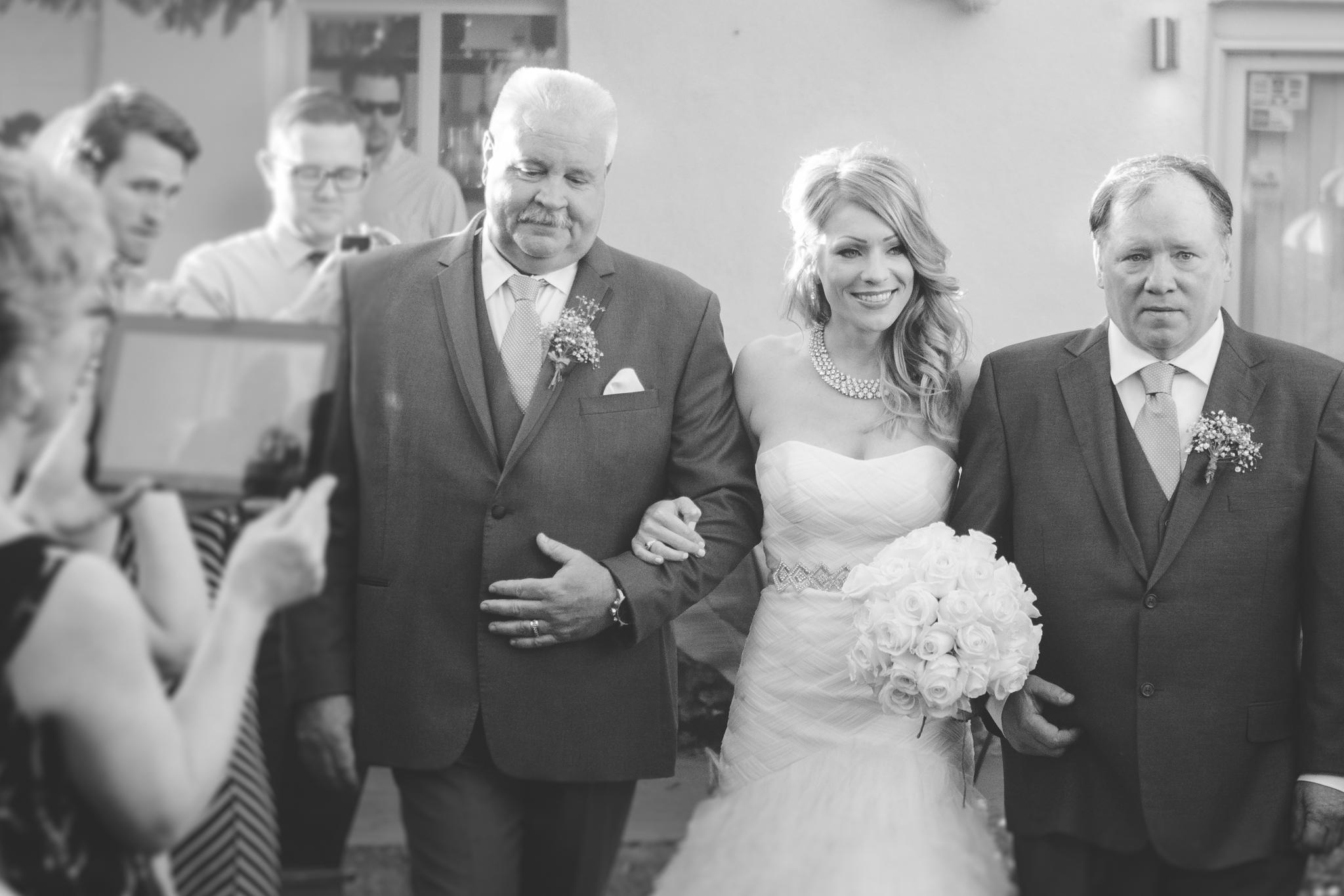 scottsdale=wedding-photographer--el-dorado-bride-walking-aisle