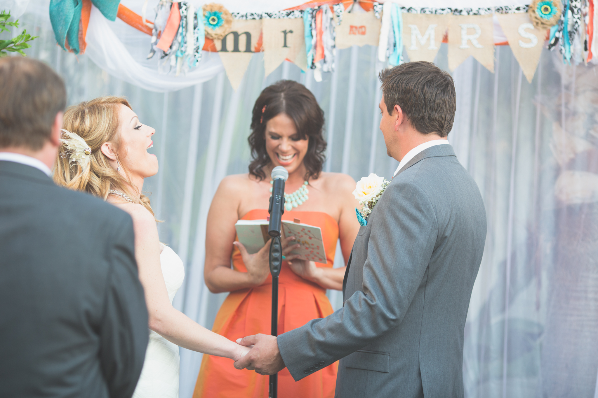 scottsdale-wedding-photographer-bride-laughing-ceremony-el-dorado