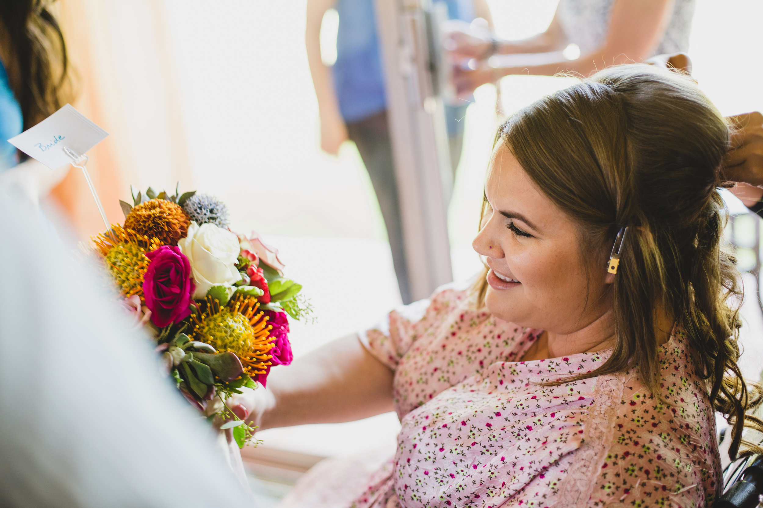 wedding-photographer-bride-checking-out-bouquet