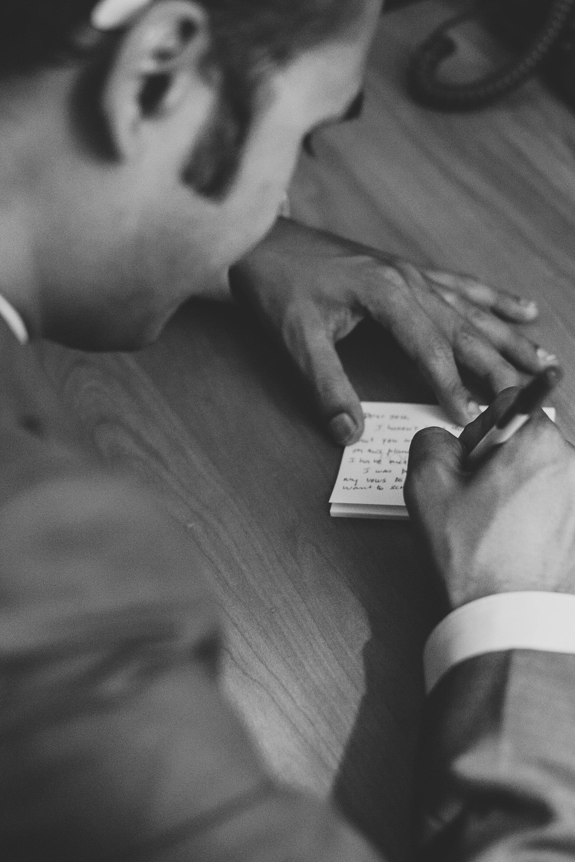 sedona-wedding-photographer-karthik-groom-writes-vows-down