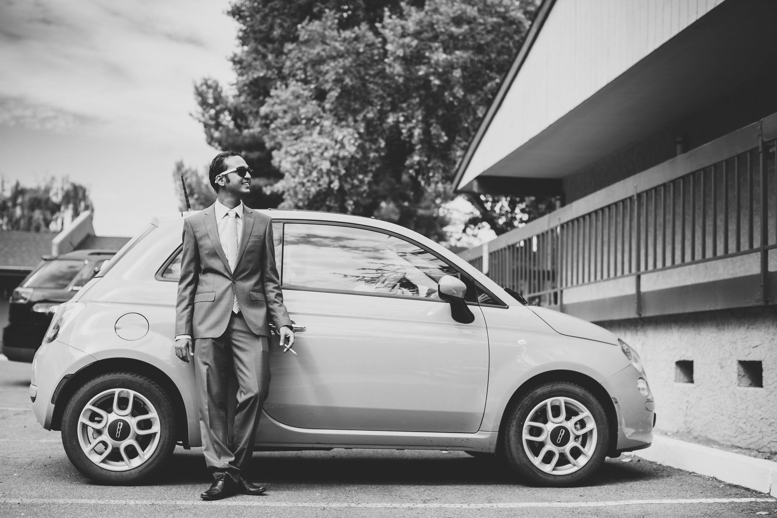 groom-smokes-by-car-bw