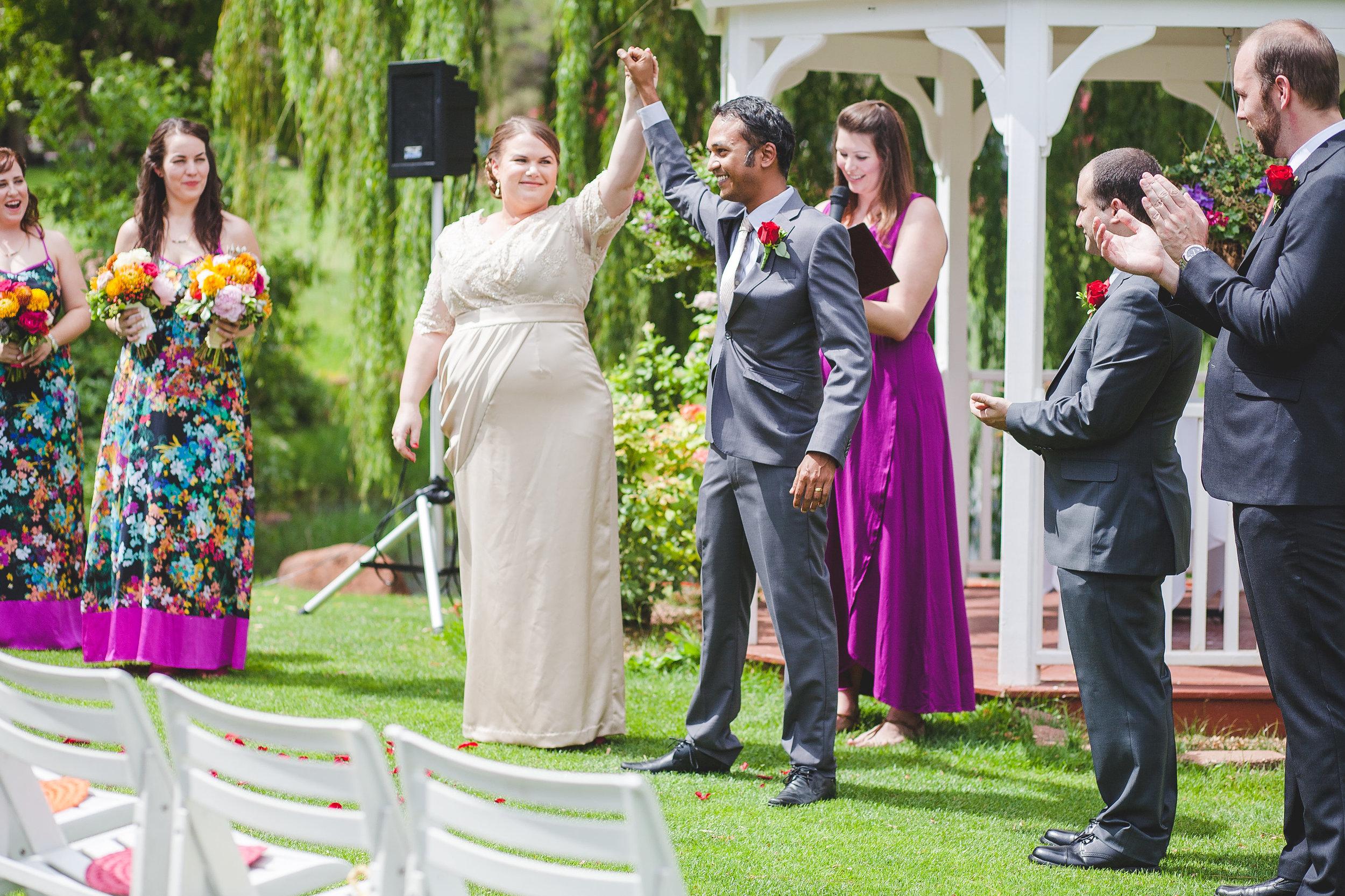 triumphant-bride-and-groom-color-sedona