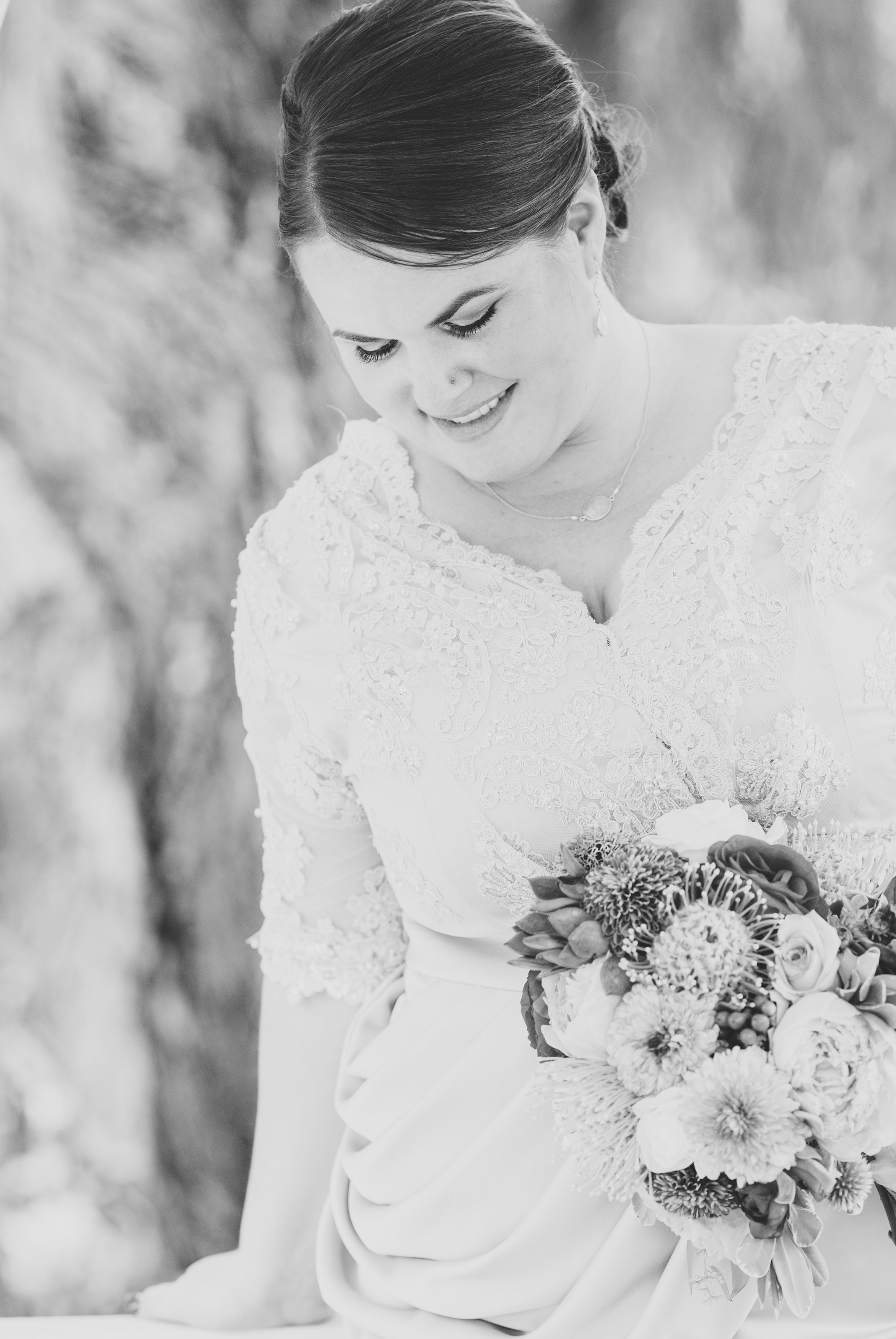 jessica-black-and-white-bride-looks-down-dramatic