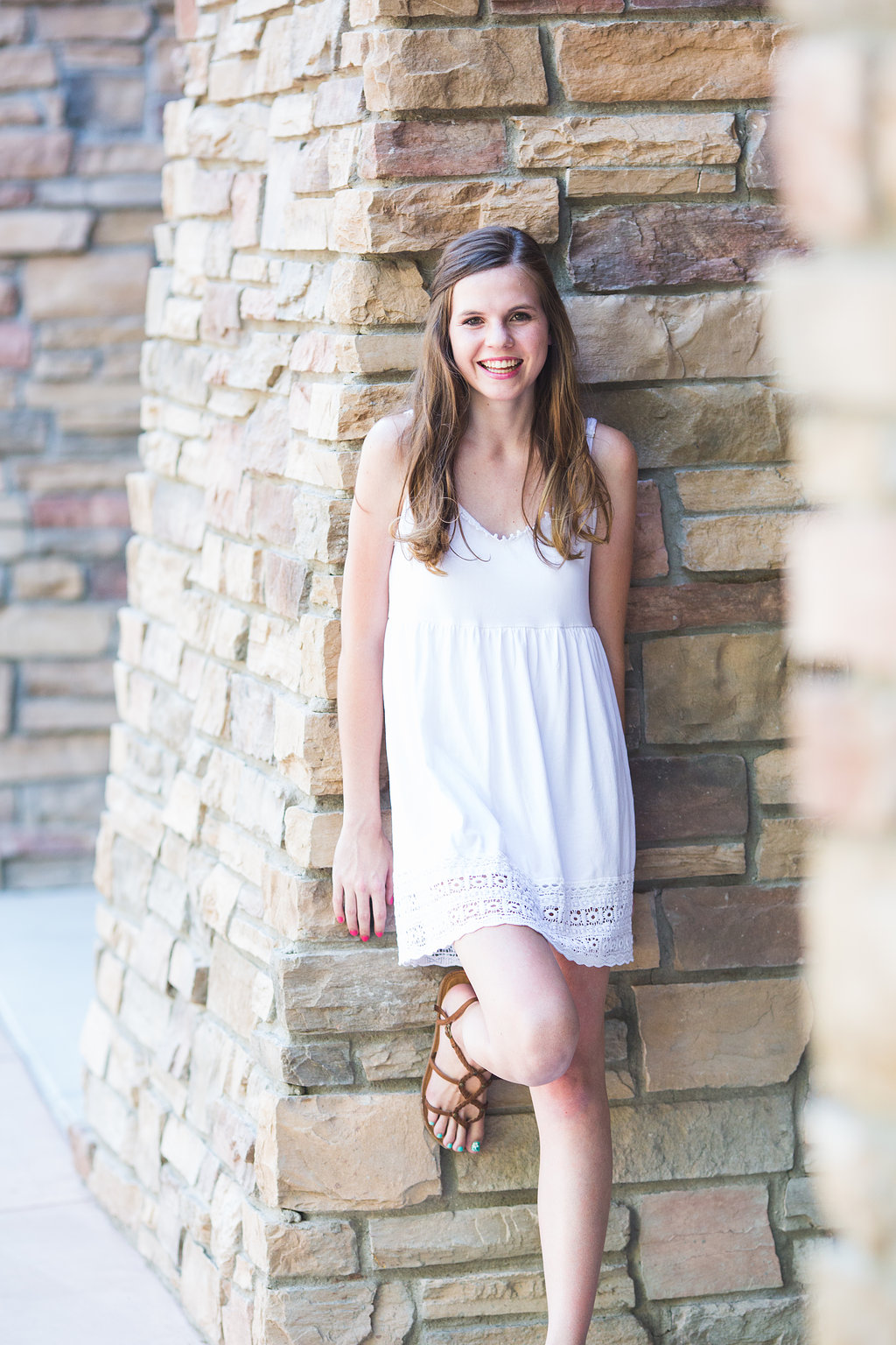 senior-photography-ccv-amber-leaning-rock-wall