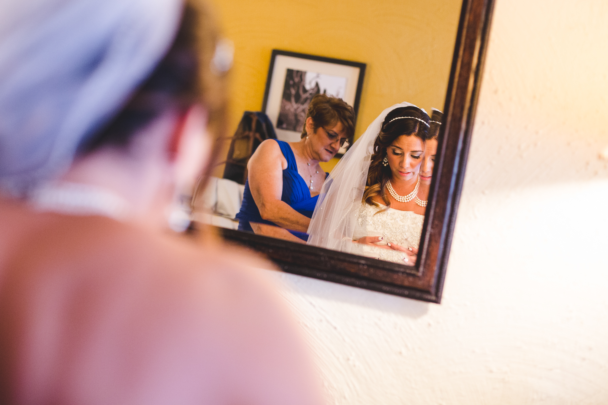 mother and bride getting dress ready