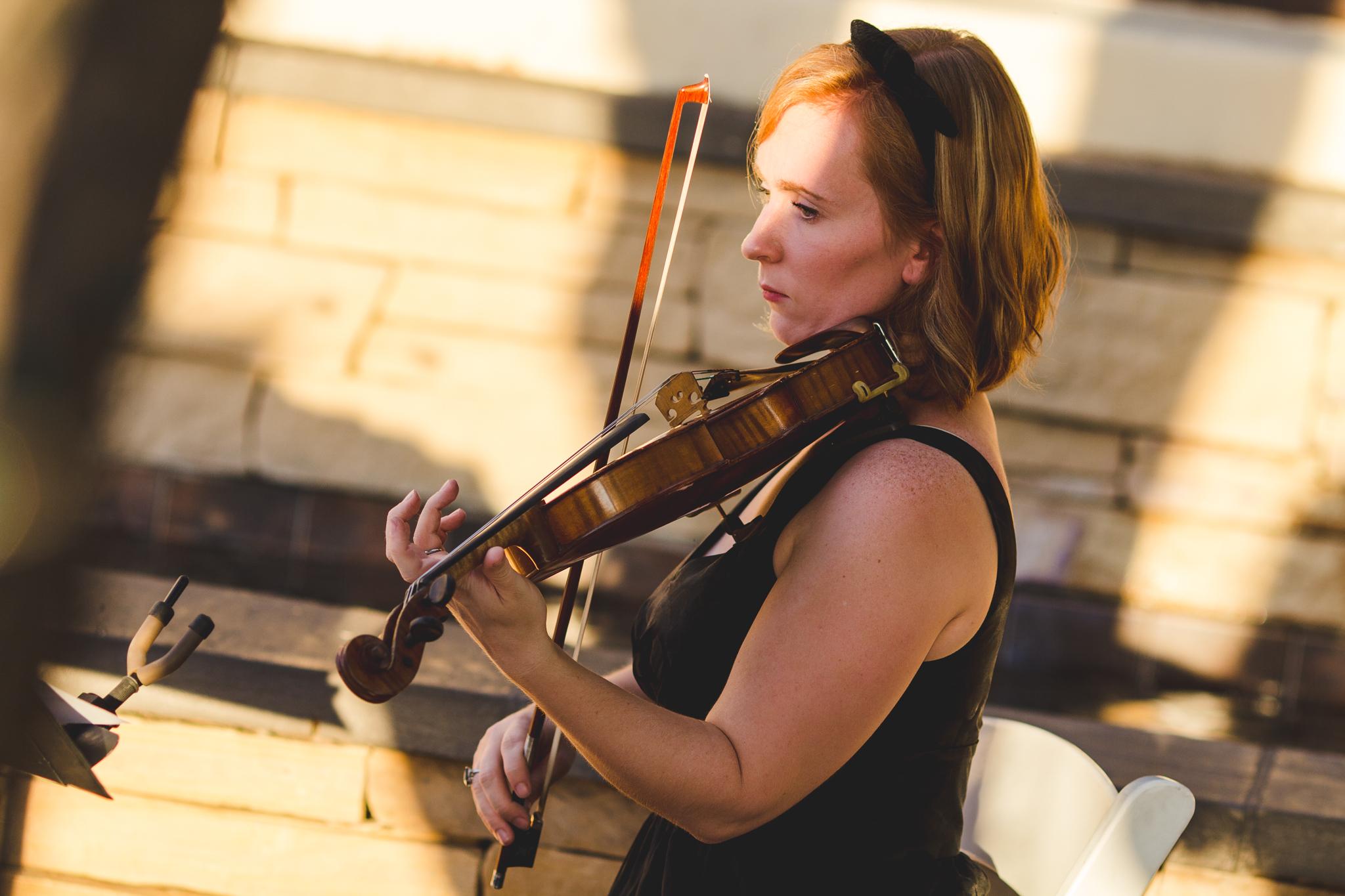 violinist plays at wedding