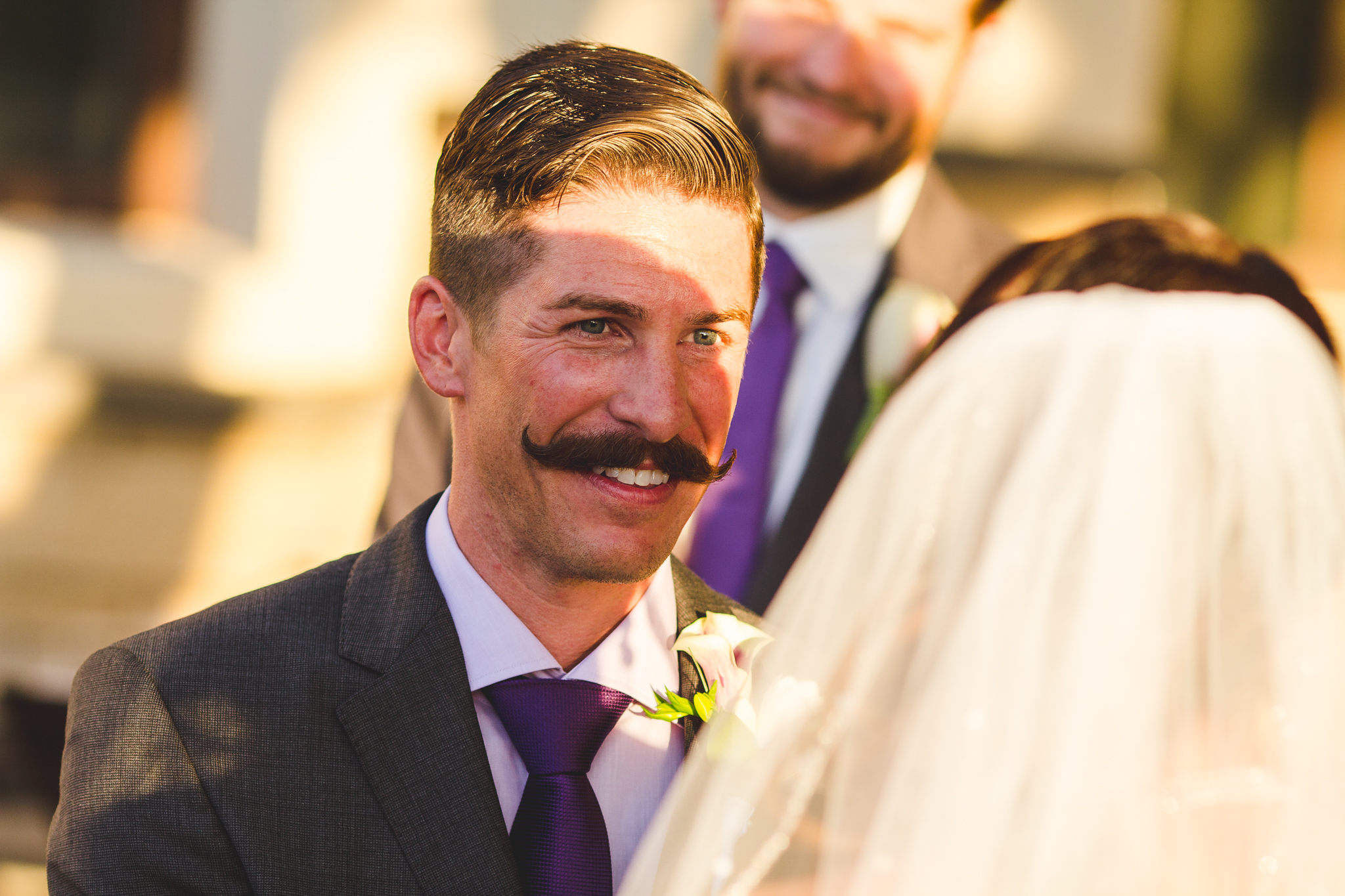 chad groom smiles on at his bride