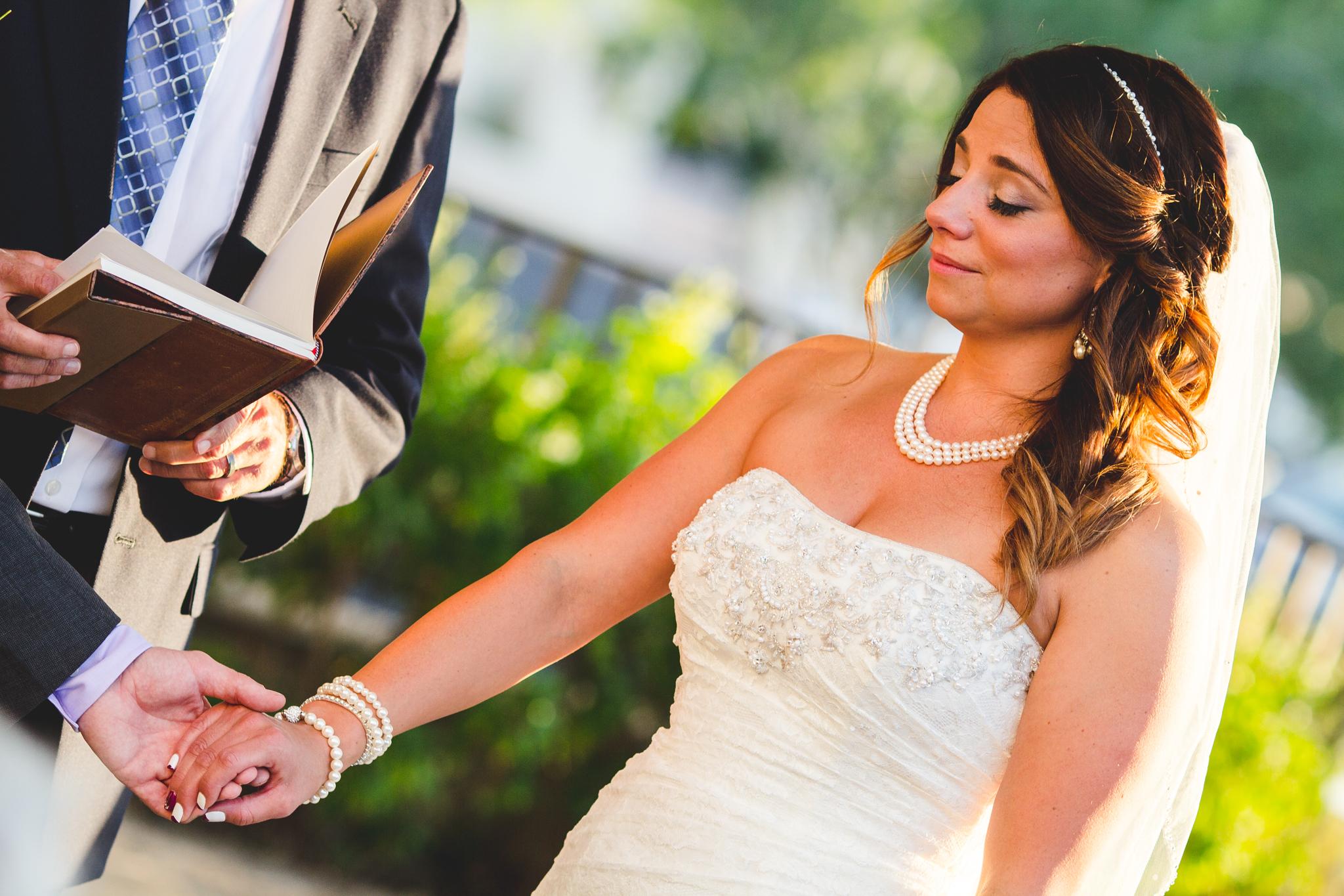 lori bride takes grooms hand