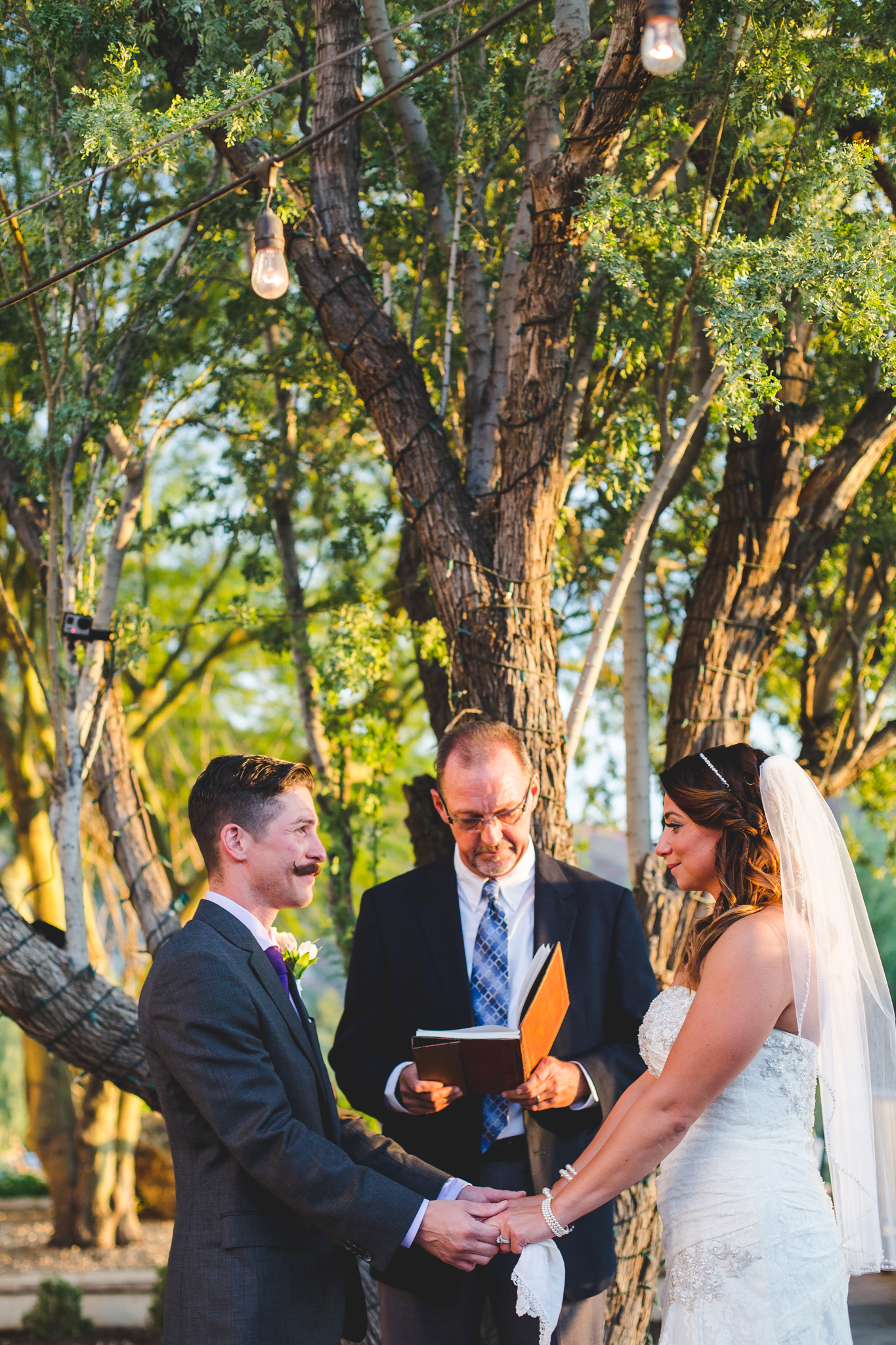 camelback inn wedding bride and groom hand in hand ceremony lc