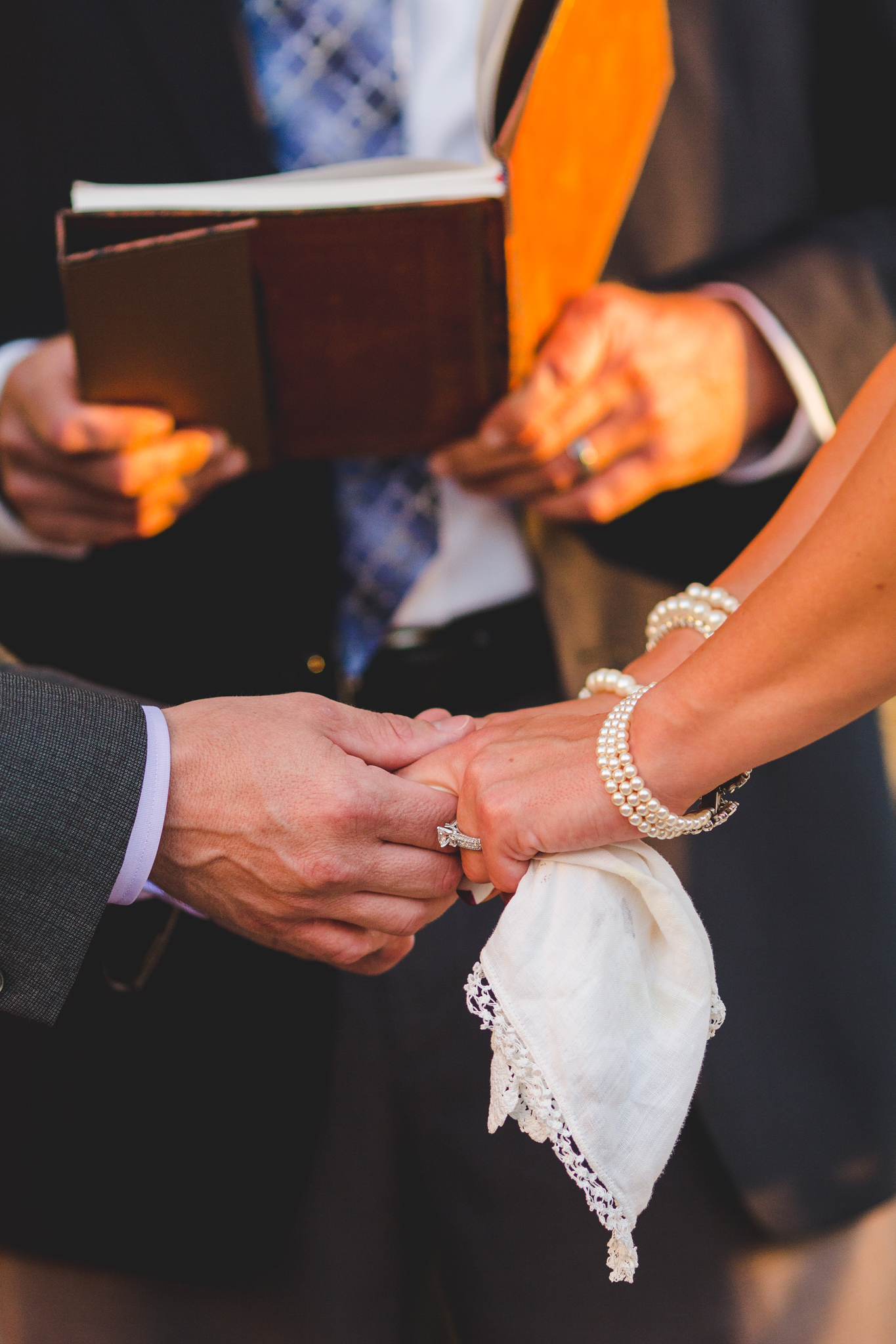 lc bride and groom holding hands ceremony