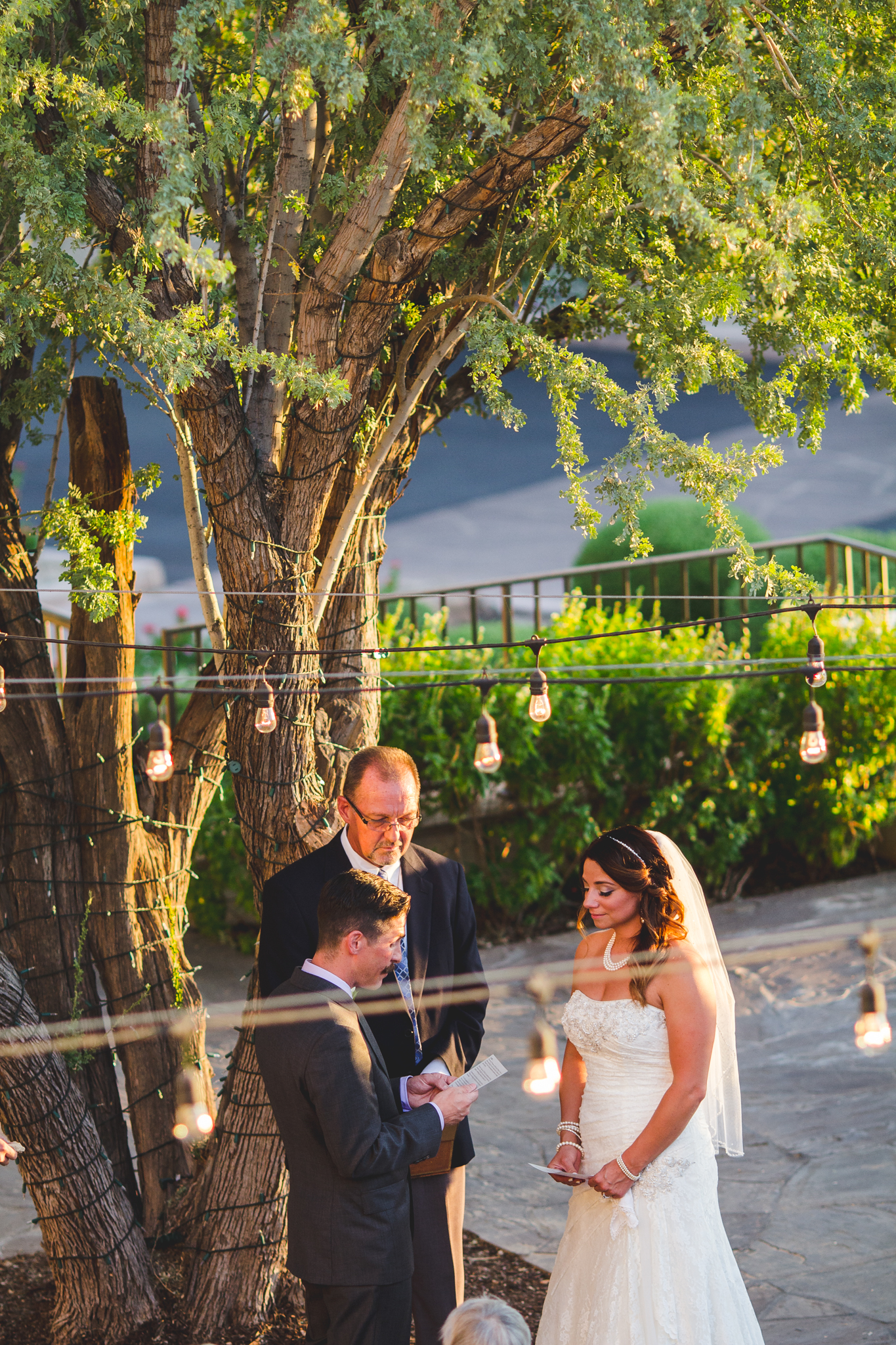 camelback inn wedding lc bride and groom read vows high angle