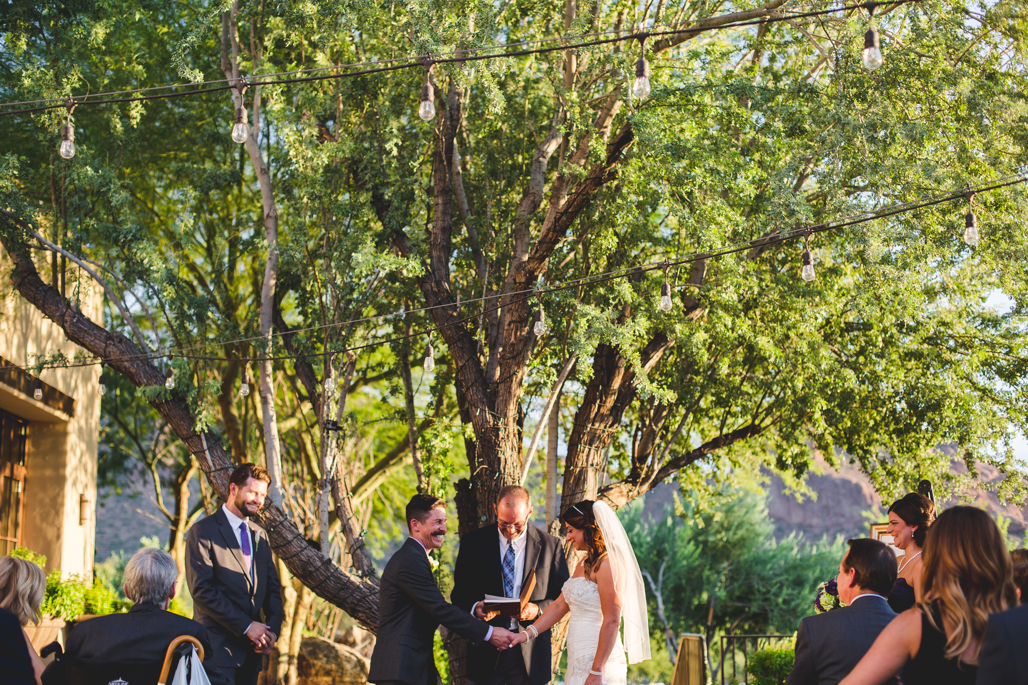 camelback inn wedding lc bride and groom laugh at ceremony