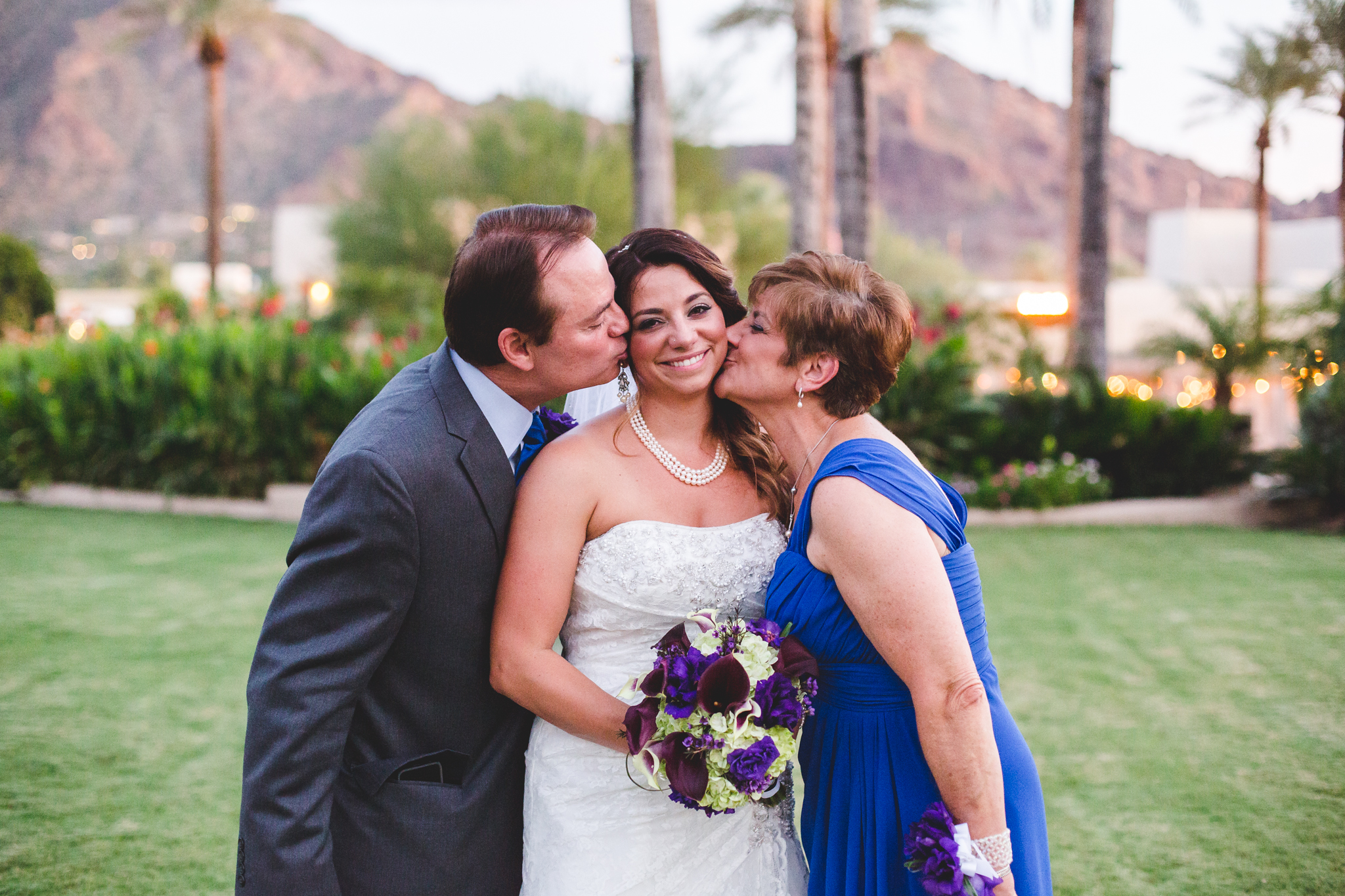 lc wedding parents kissing daughter