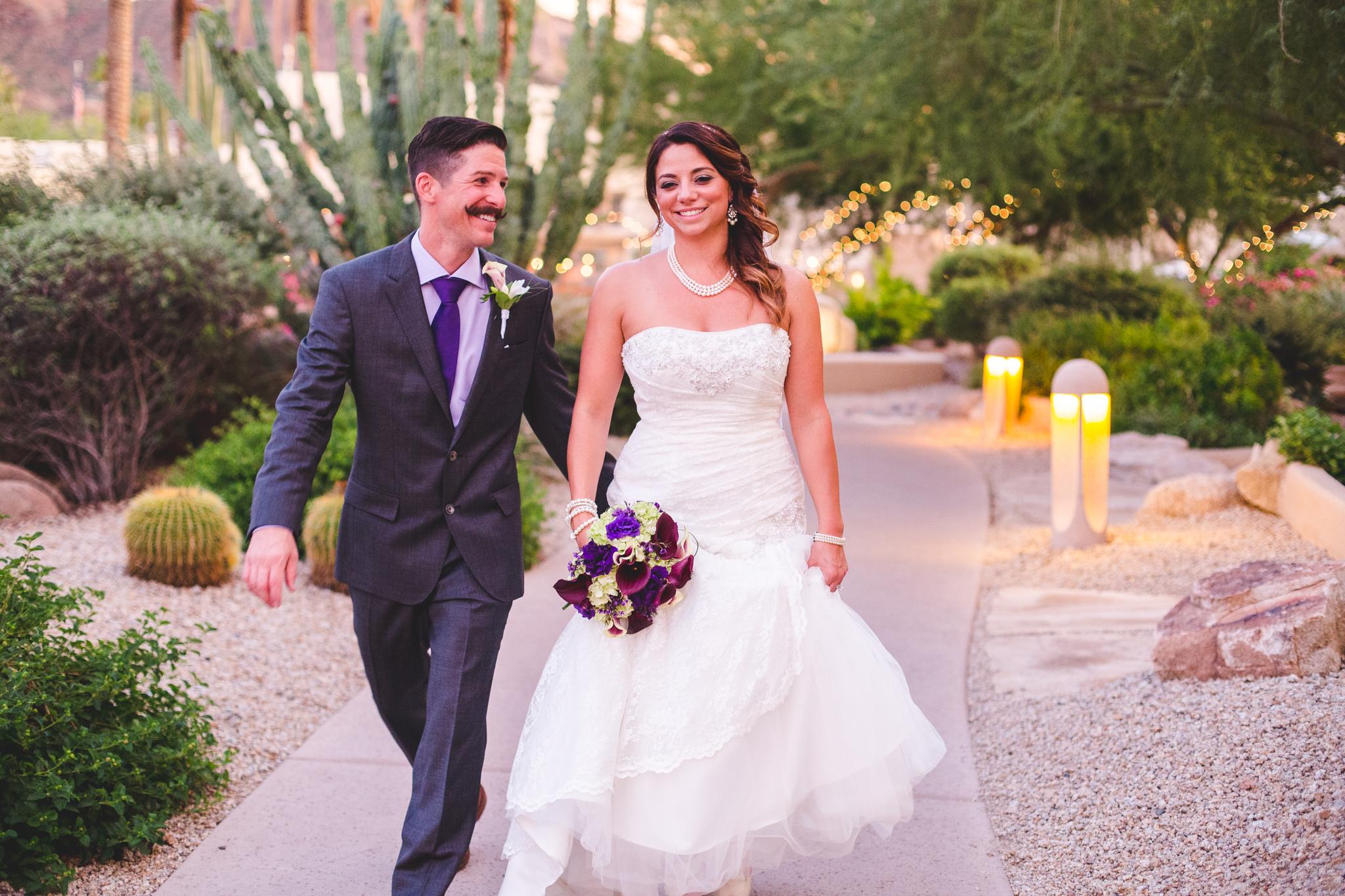 beautiful camelback inn wedding bride and groom walking happy lc