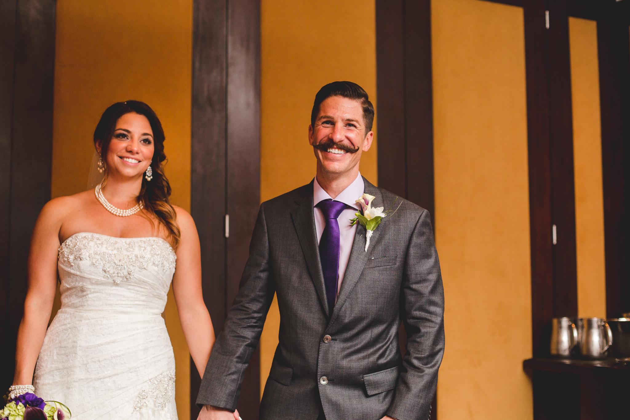 lc bride and groom enter reception