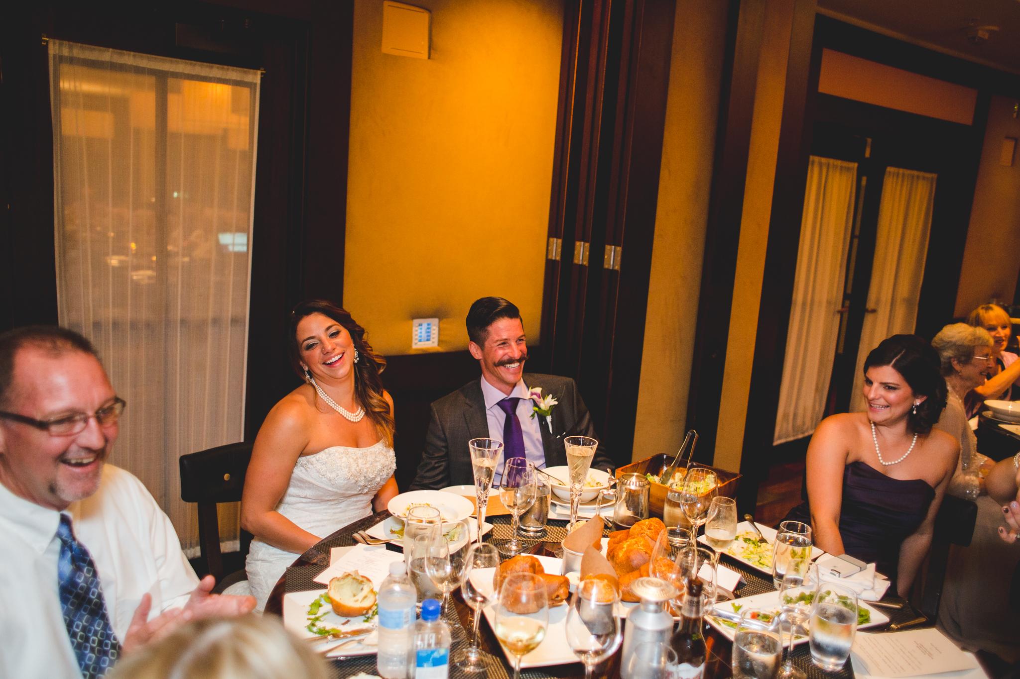 lori bride laughs during reception