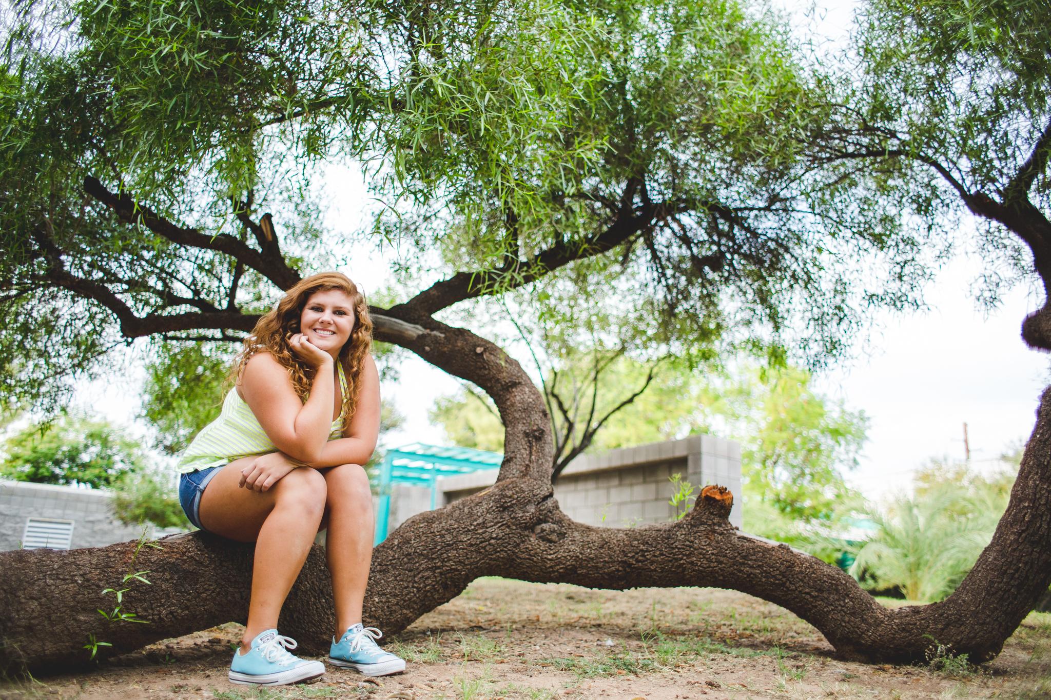 Cool Wide Angle Senior Photo Marissa Sits on Tree