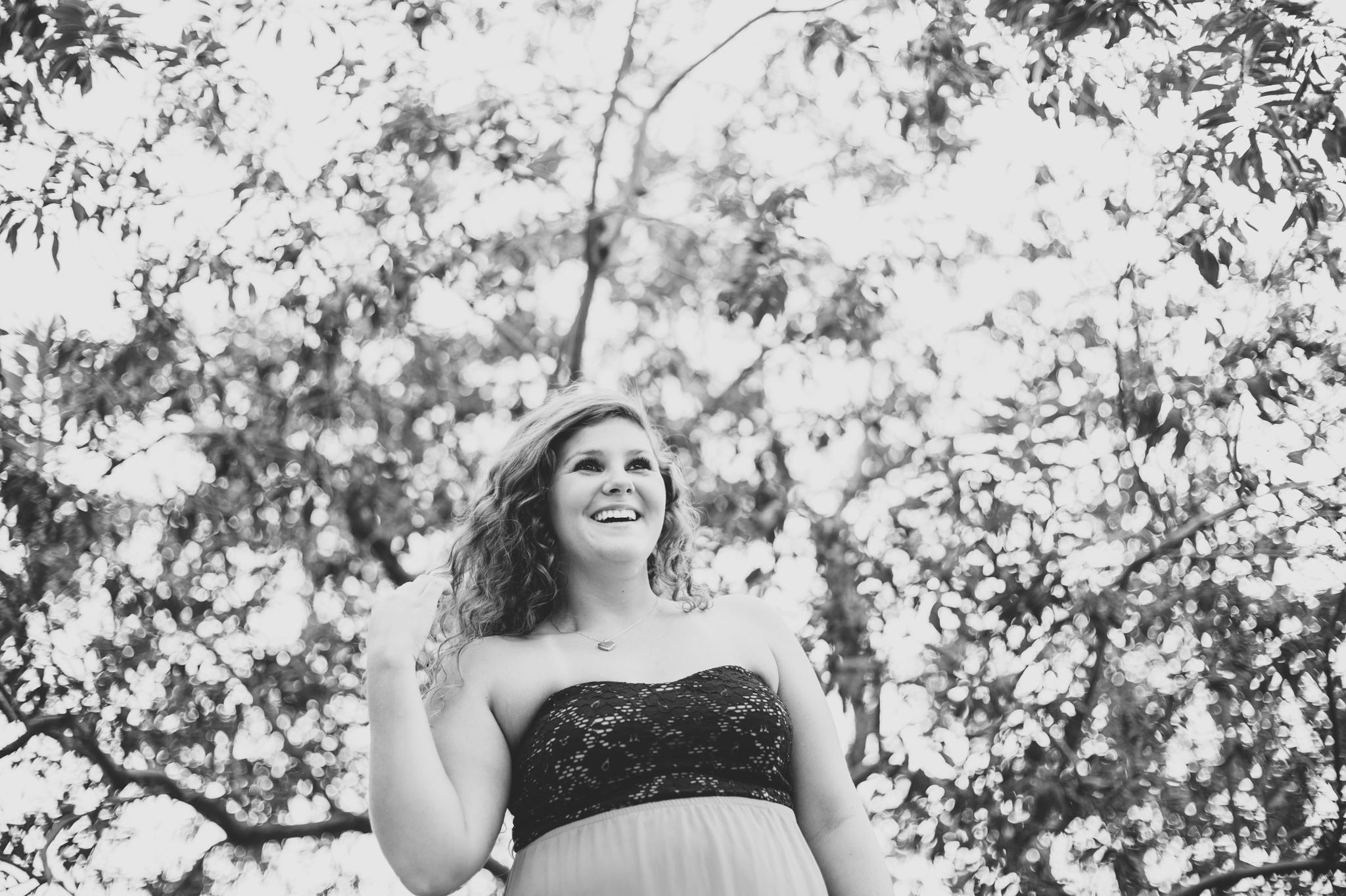 Marissa BW Laughs Beneath Tree Senior Photo