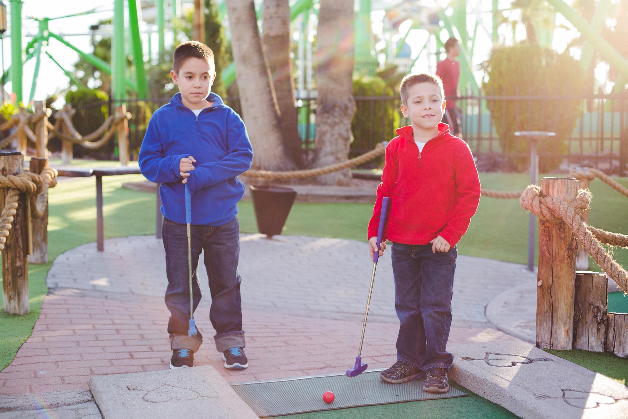 the boys prepare to start mini golf