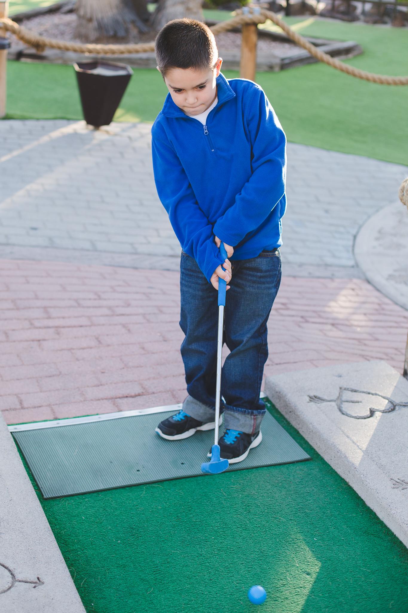 john teeing off mini golf castles n coasters