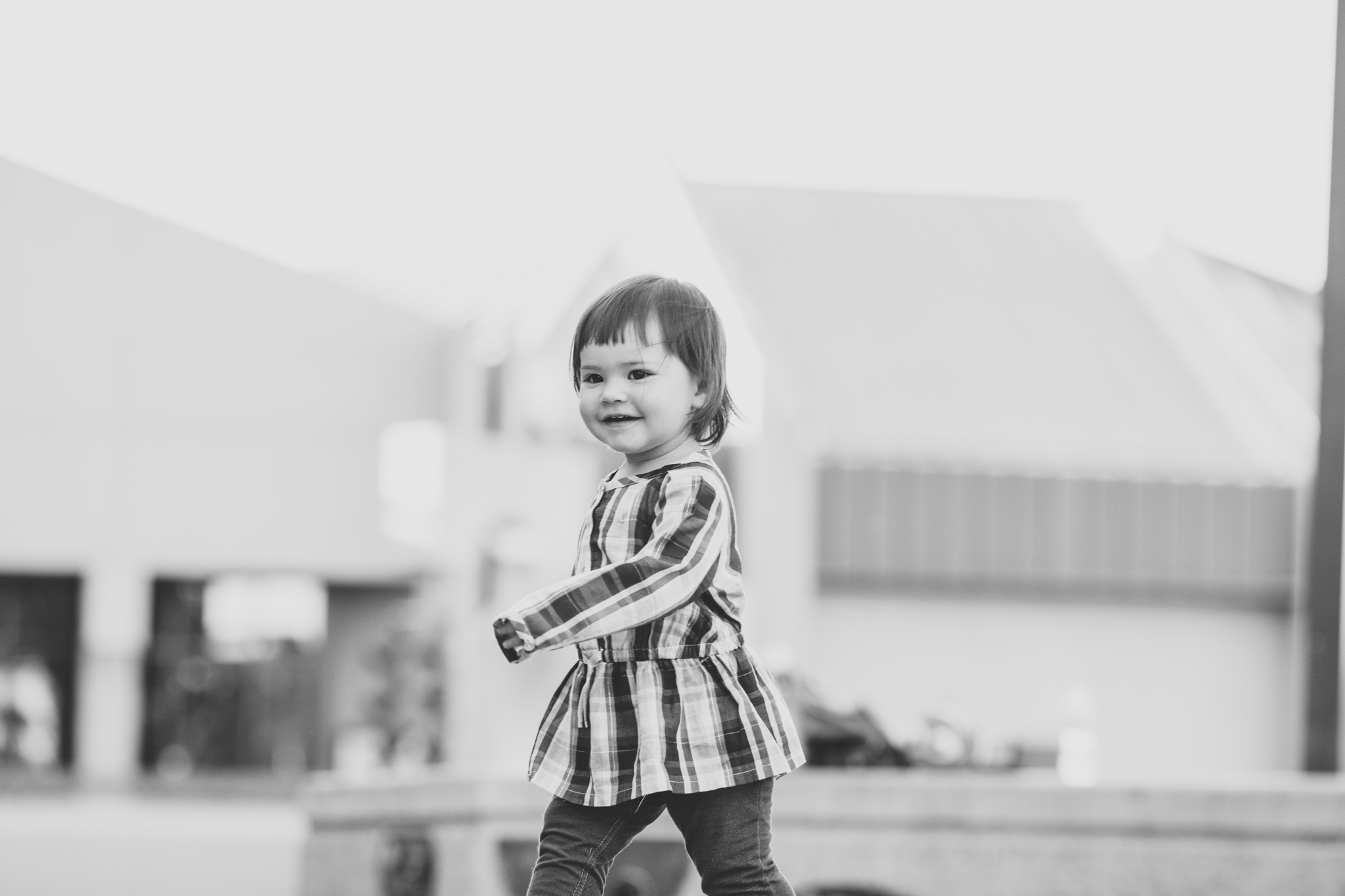 adorable baby mae smiling black and white family photographer glendale az