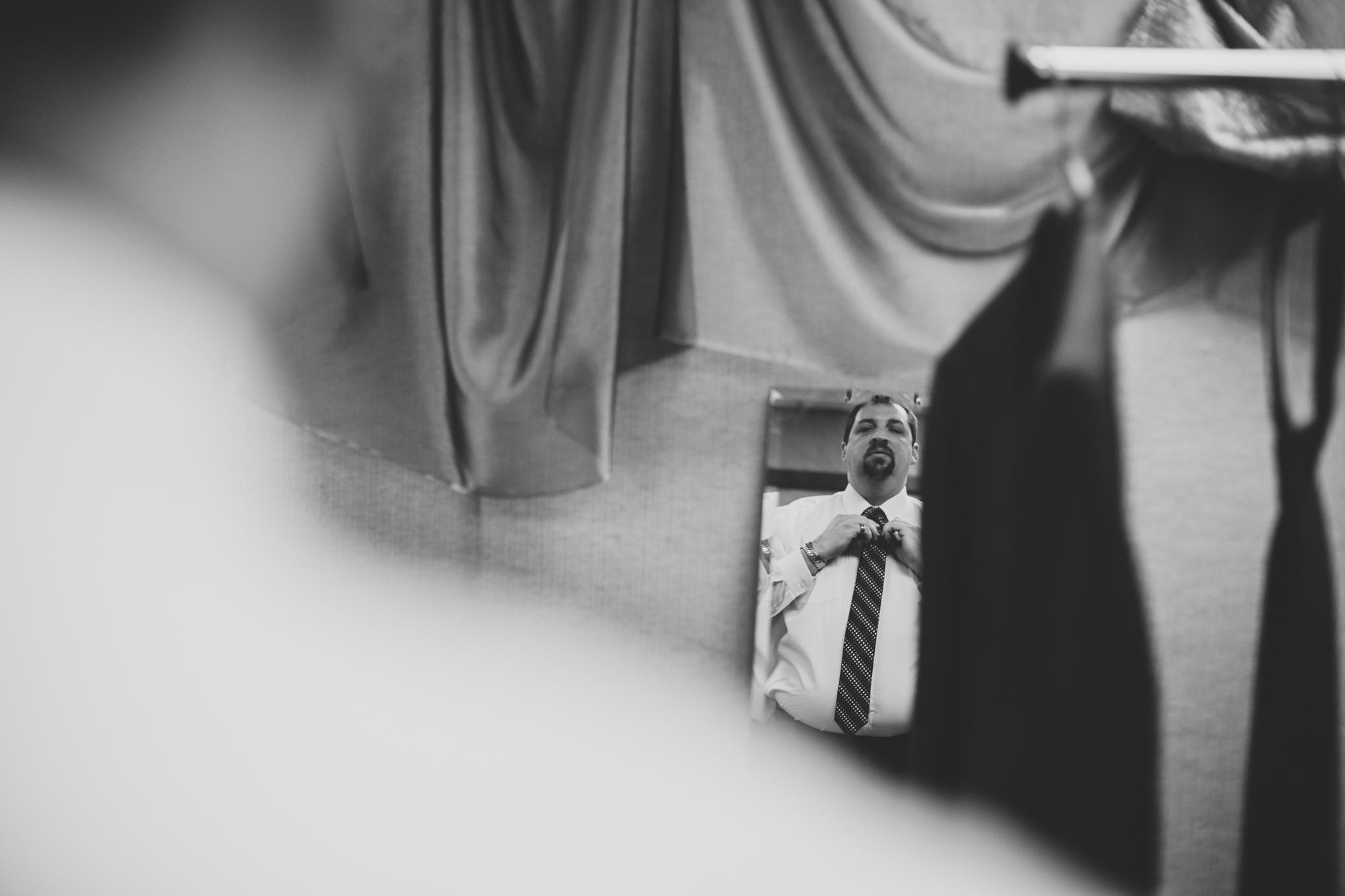 rs oklahoma city wedding groom looks in mirror black white