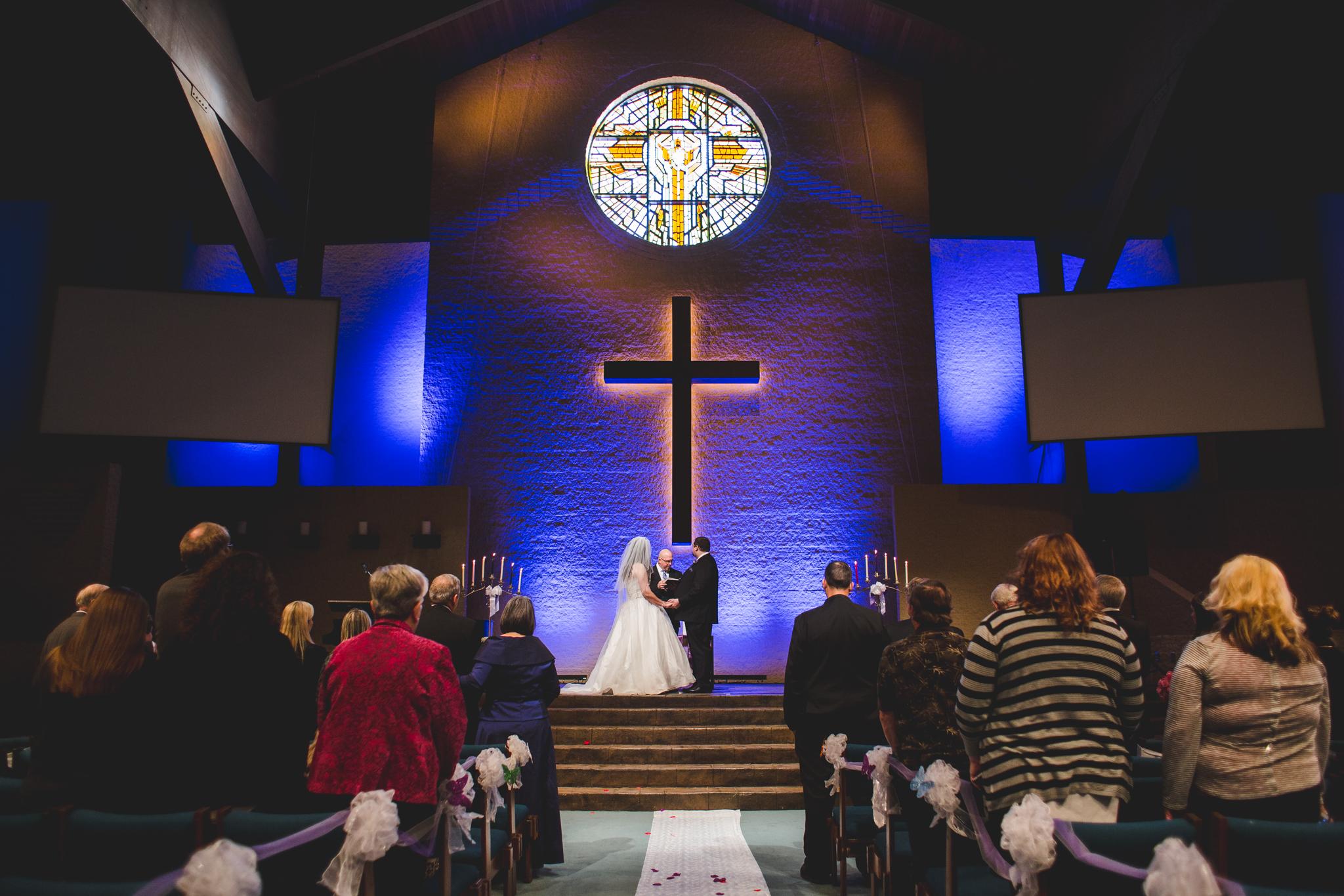 rs bride and groom at altar oklahoma city wedding