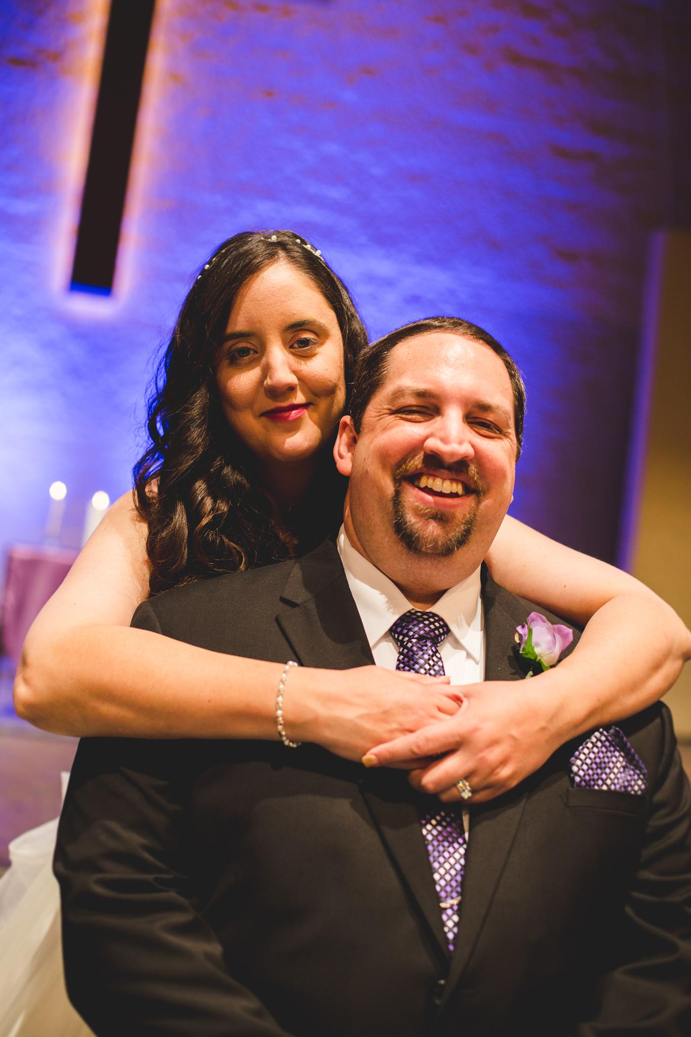 rs bride wraps arms around groom