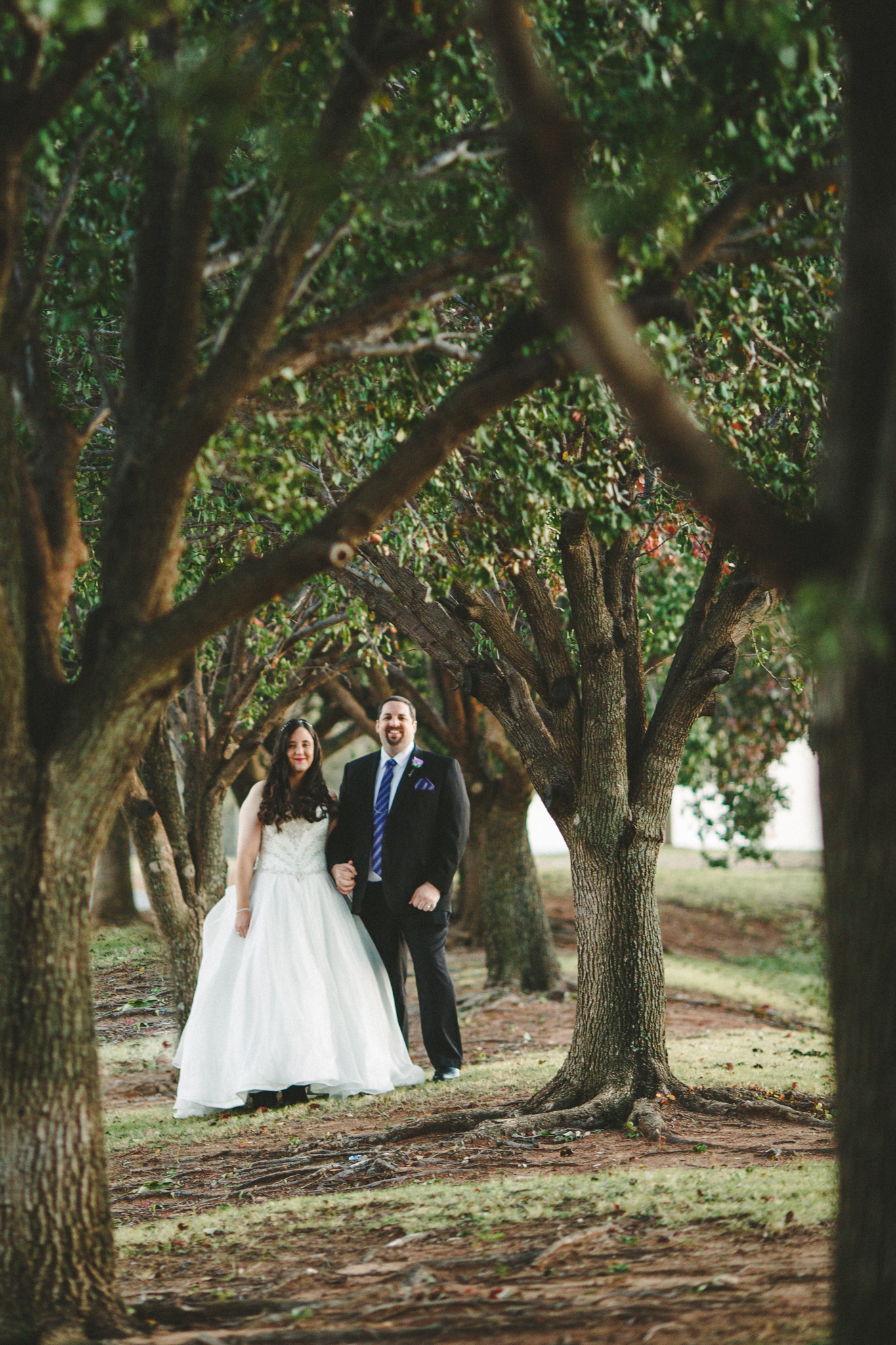 rs bride groom creative portrait among tress greenery oklahoma city