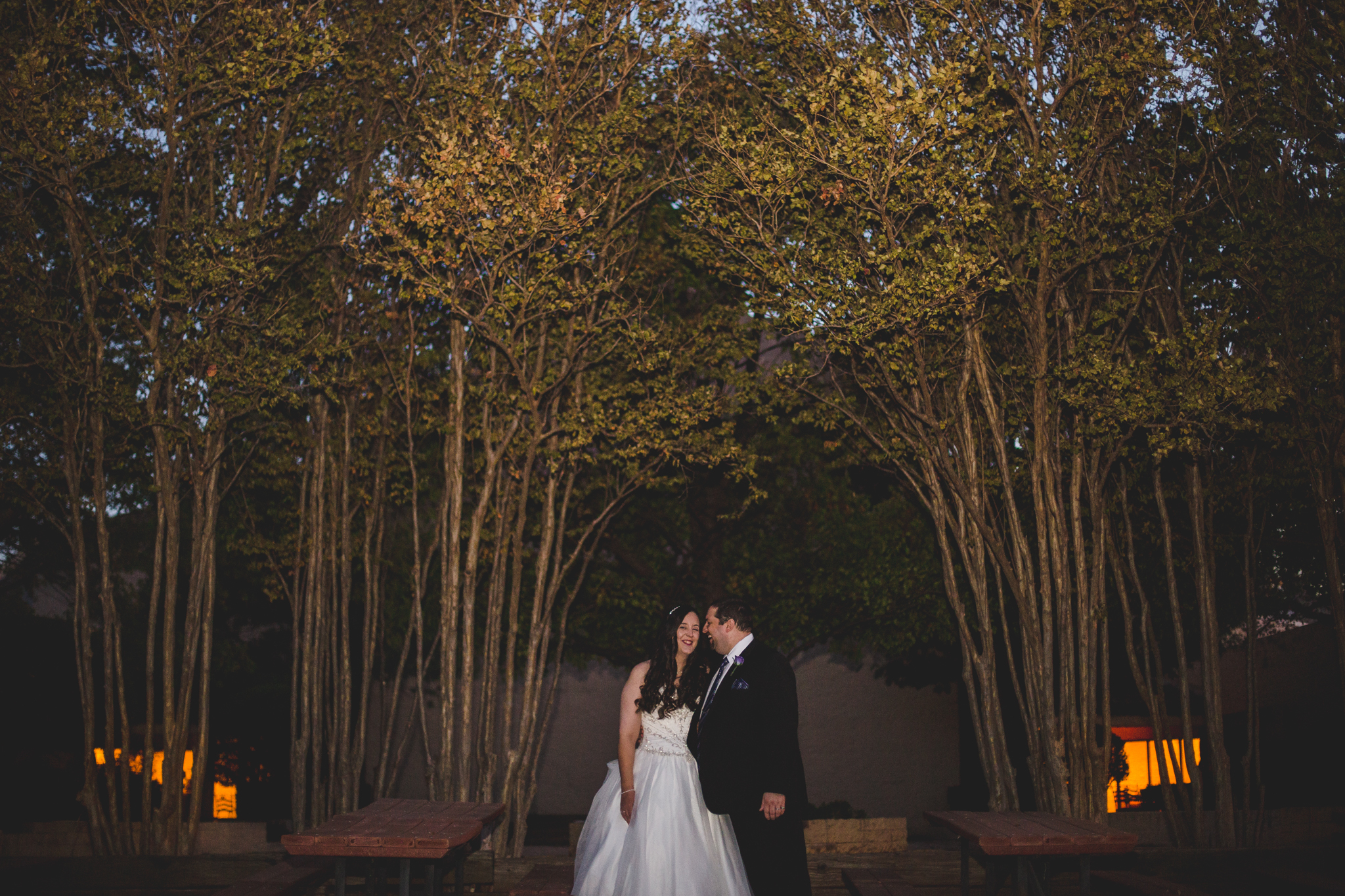 rs creative bride and groom laugh among trees at night cool