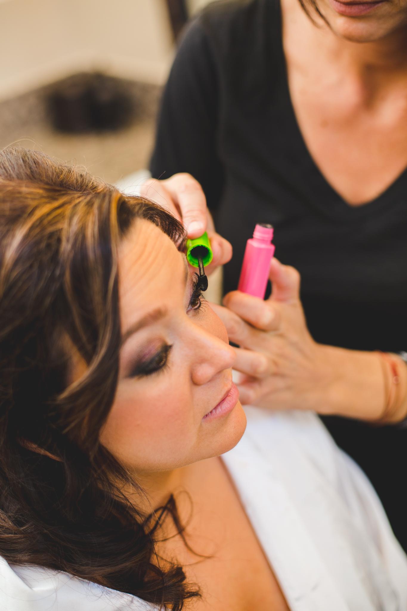 bride getting makeup done mj