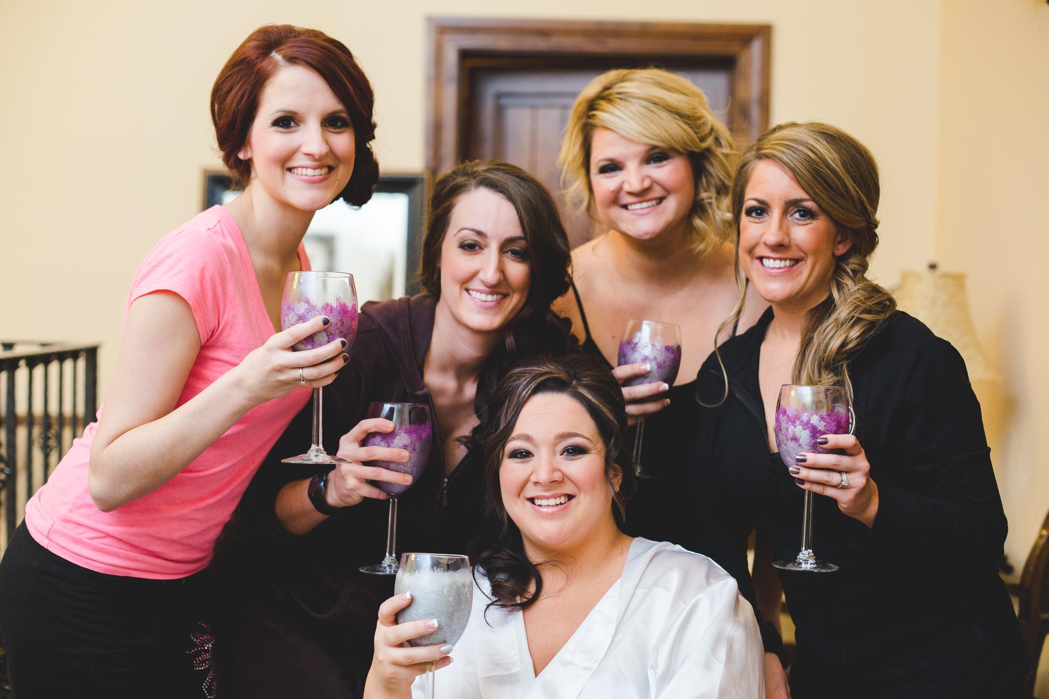 bridesmaids and bride having drinks pre wedding mj
