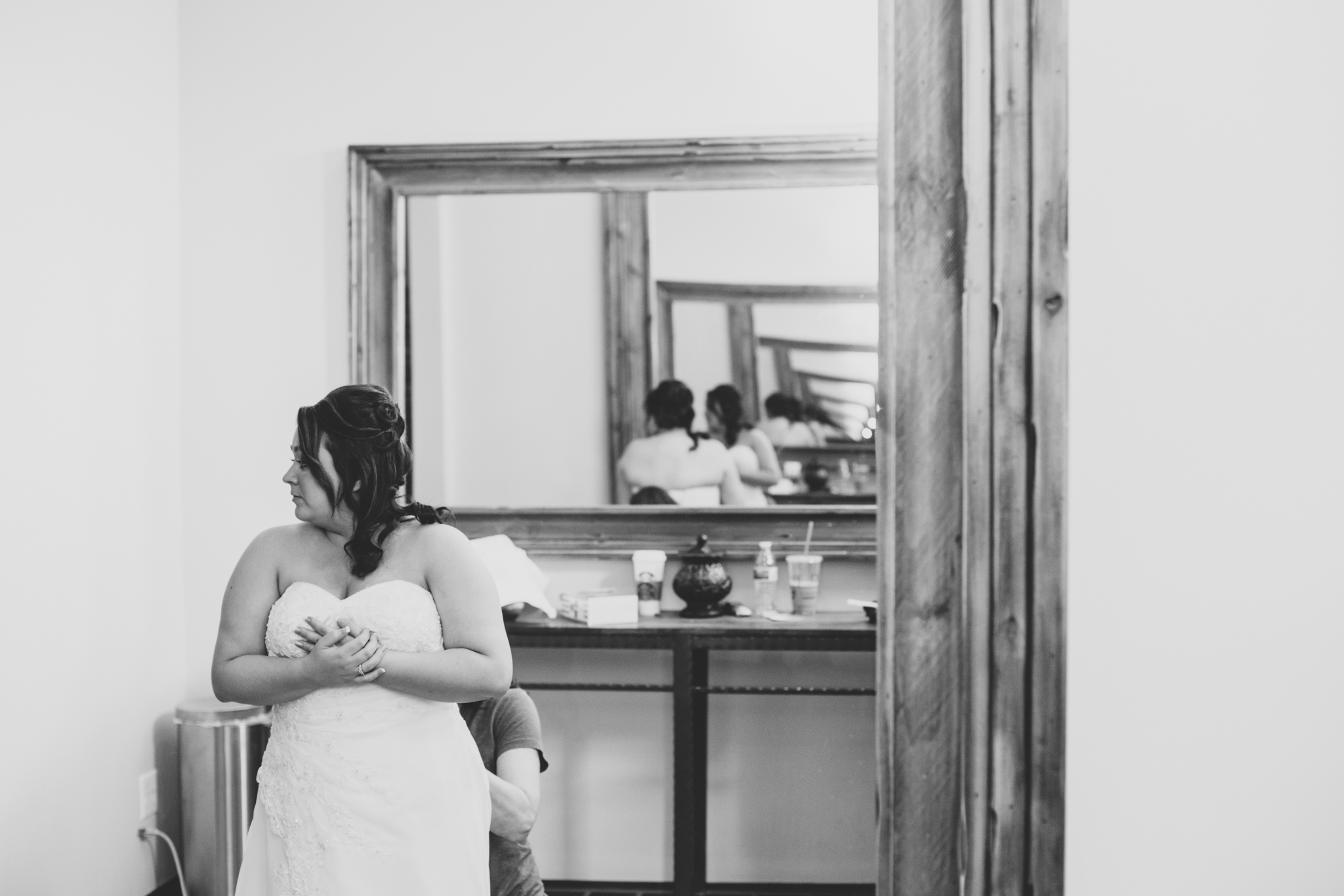 bw bride getting dress tied up mj