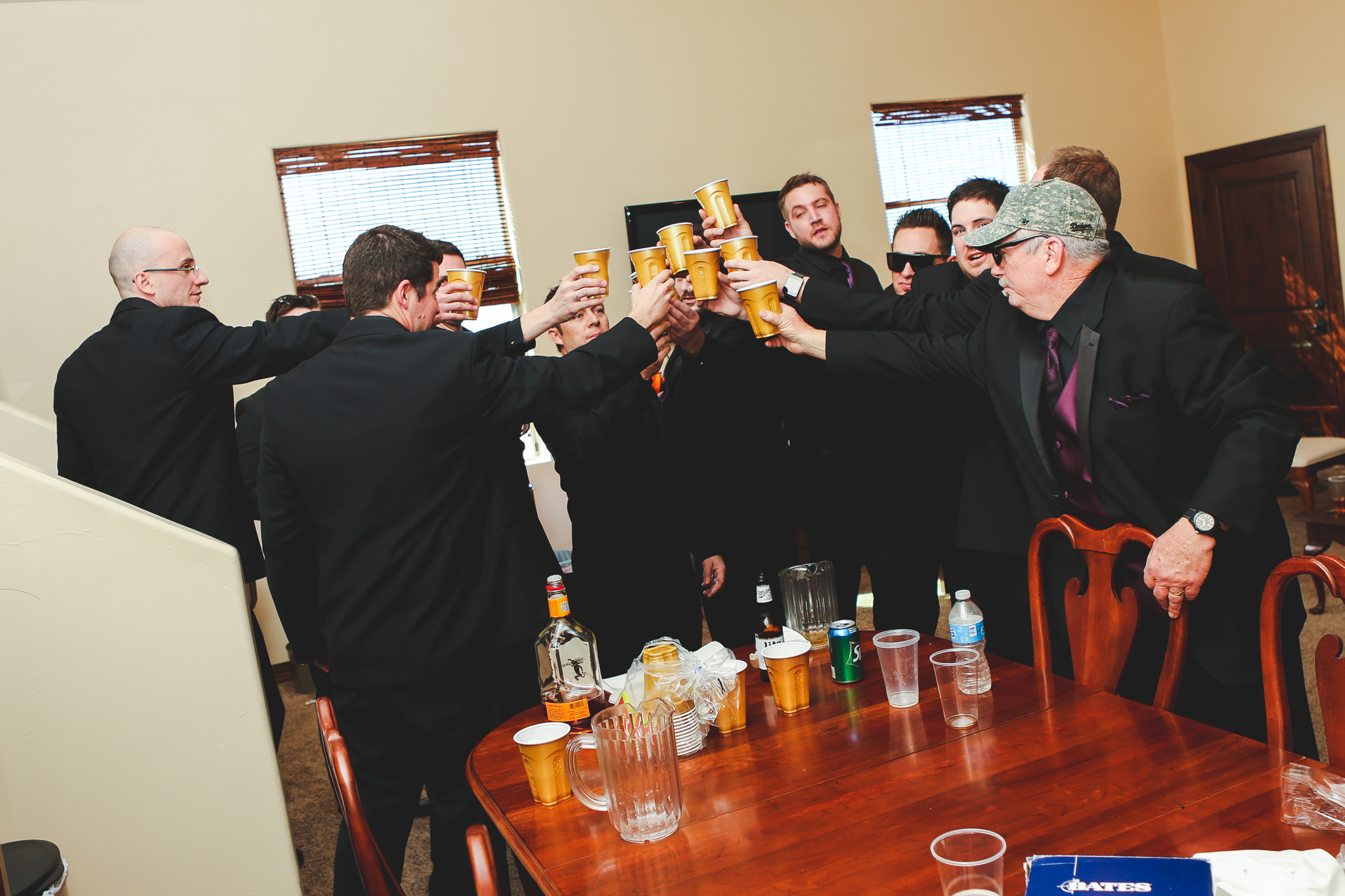 groom and groomsmen have a getting ready toast mj