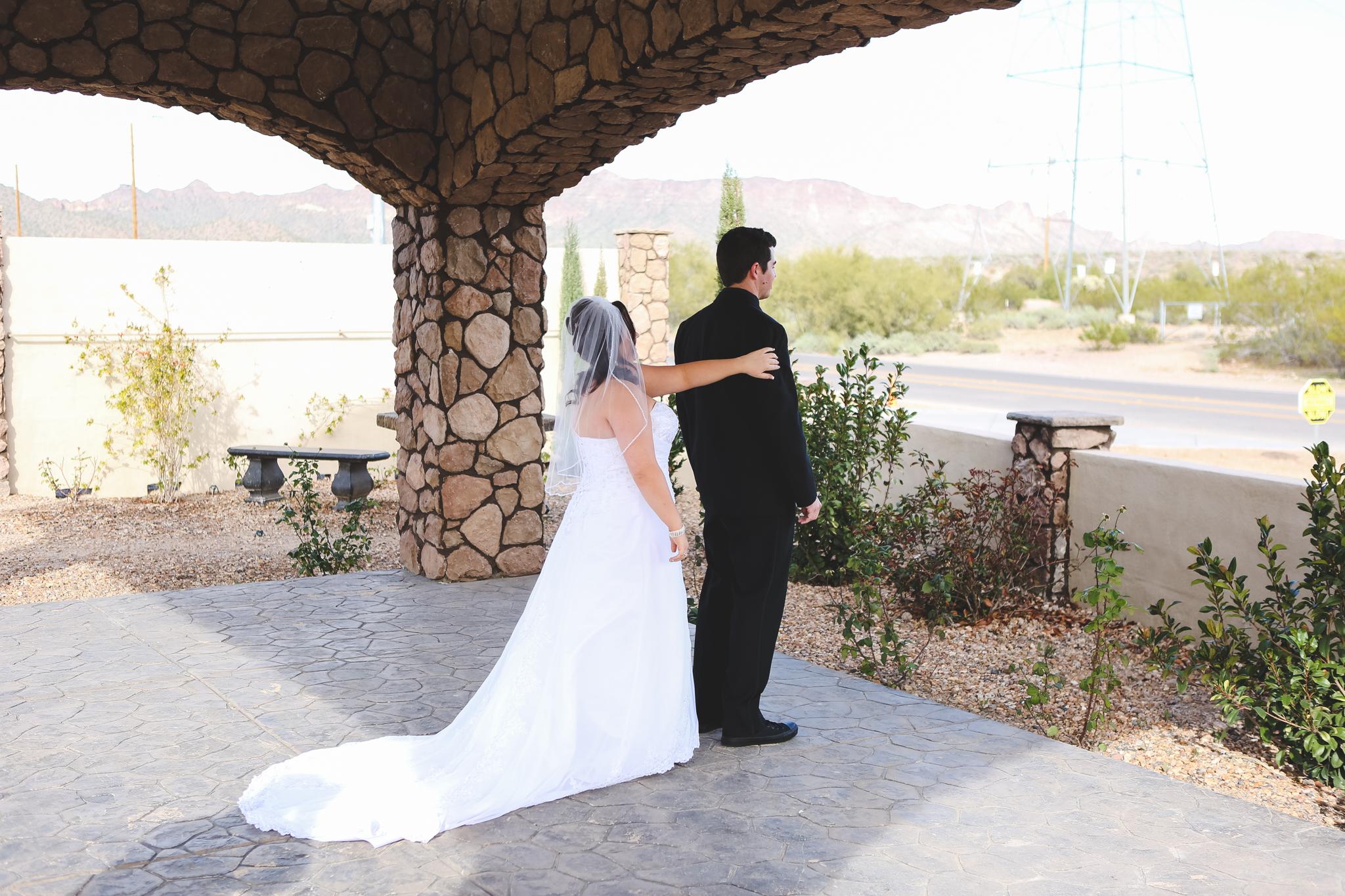 first look bride grabs groom mj