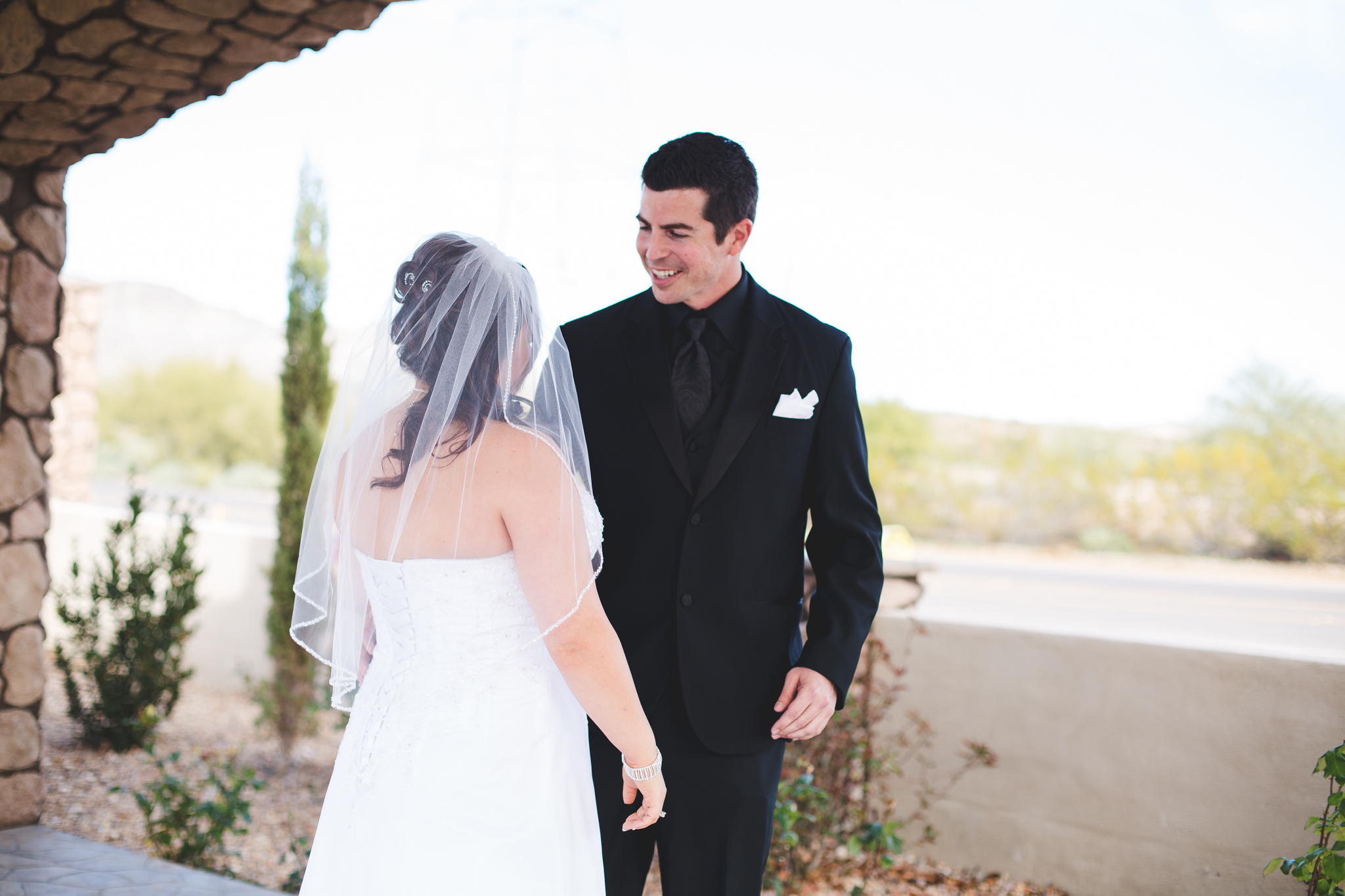 groom smiles at bride first look reaction mj