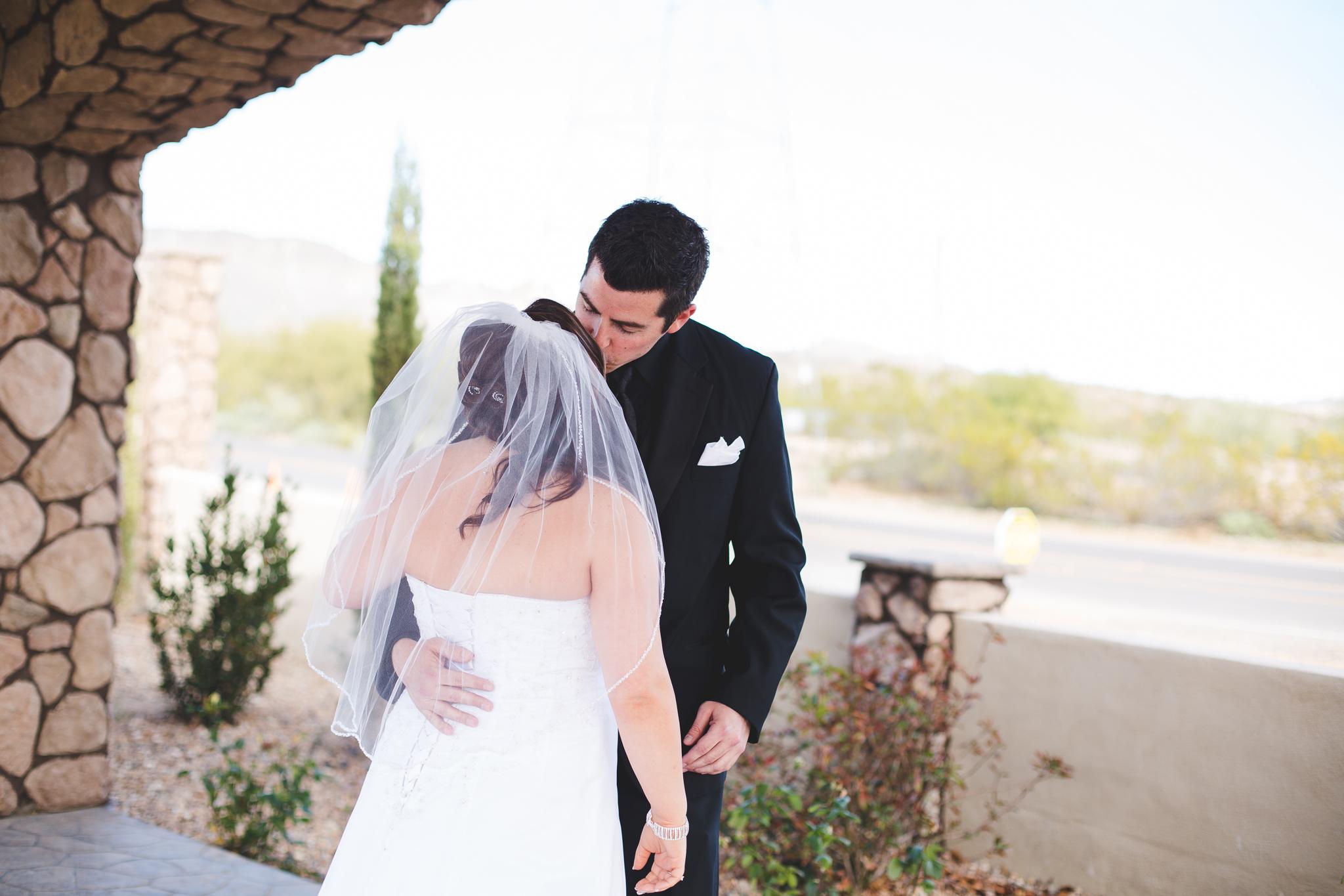 groom kissing bride first look mj