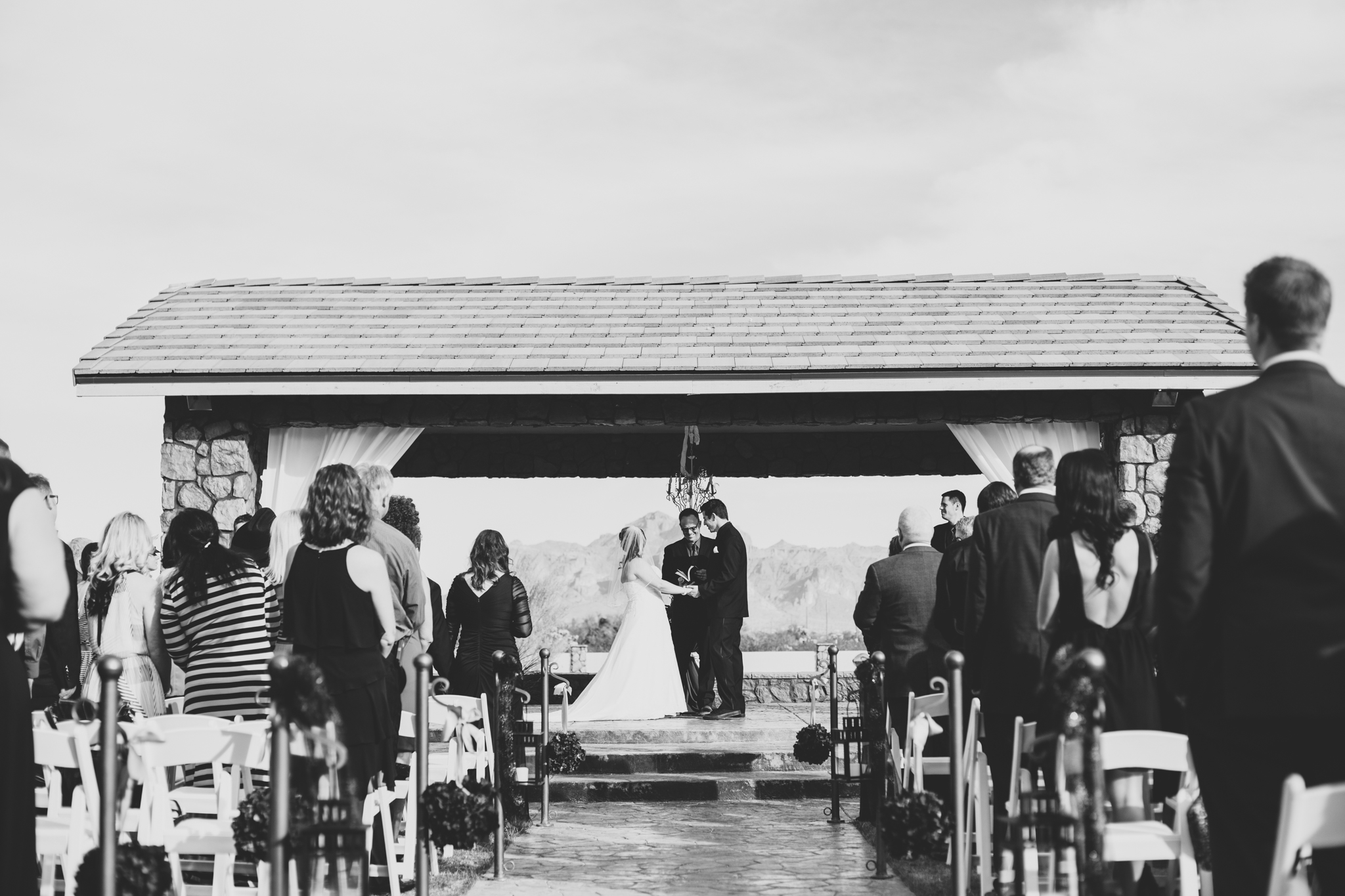 wide angle superstition manor ceremony bw from aisle mj