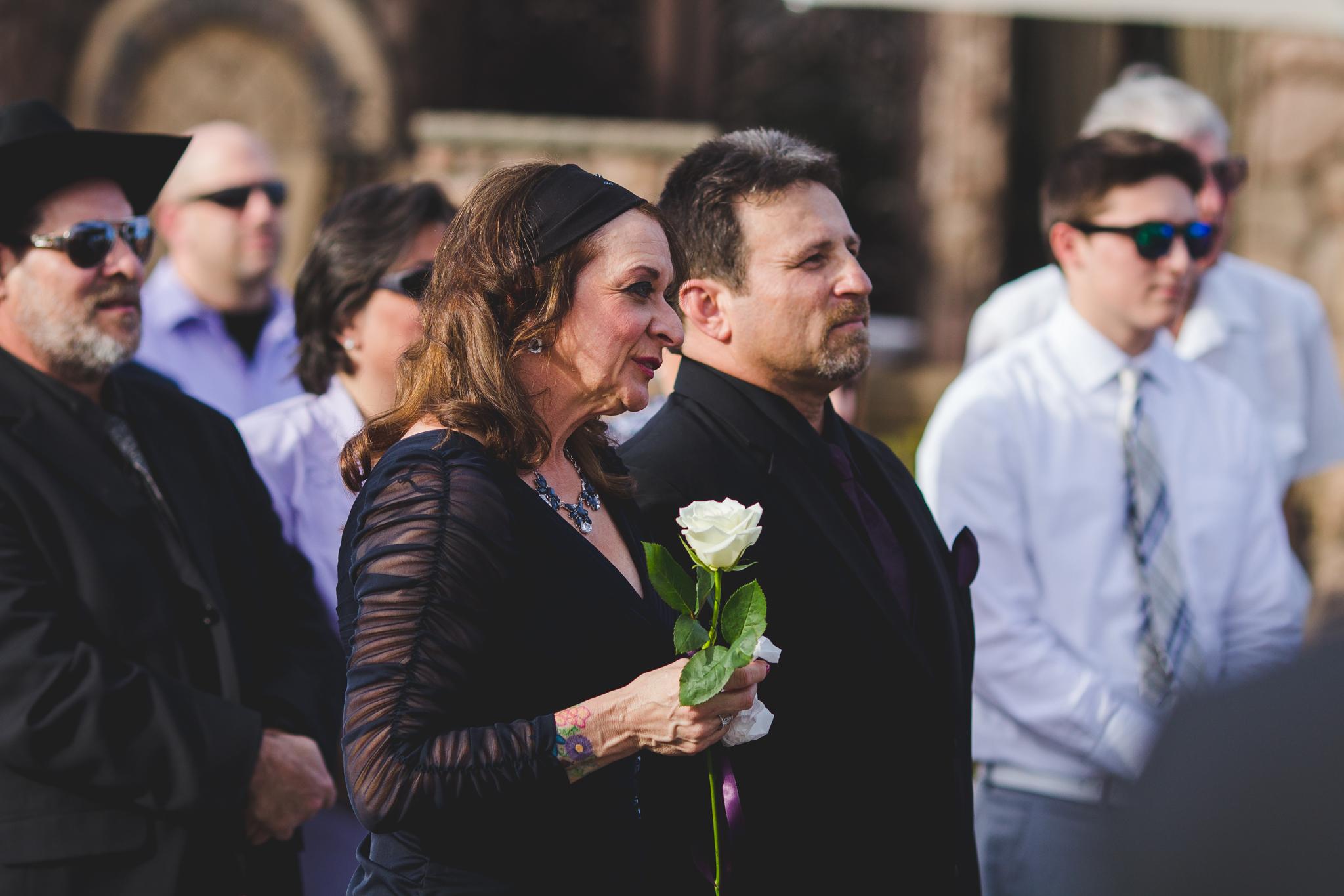 parents of bride look on ceremony