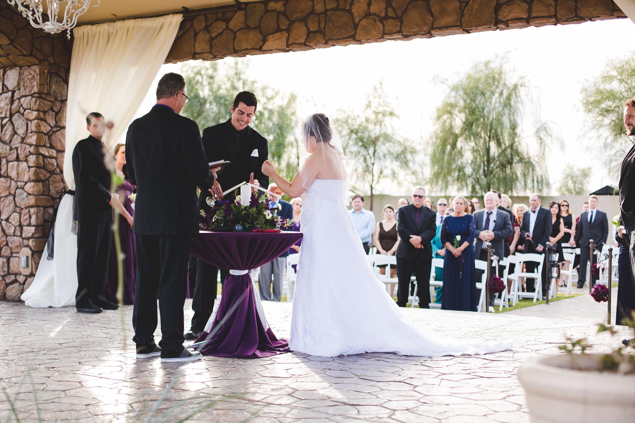 bride groom lighting candle ceremony mj