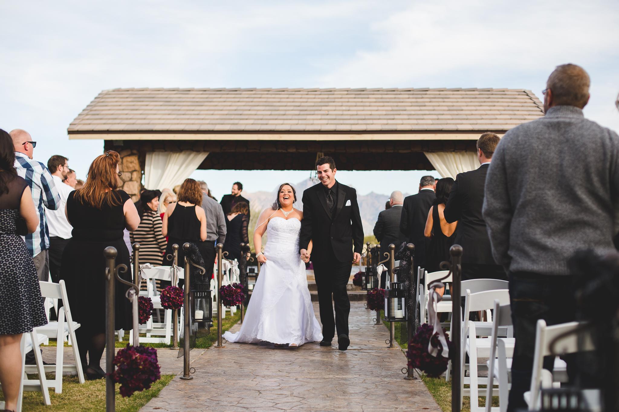 bride and groom walk down aisle as husband and wife mj