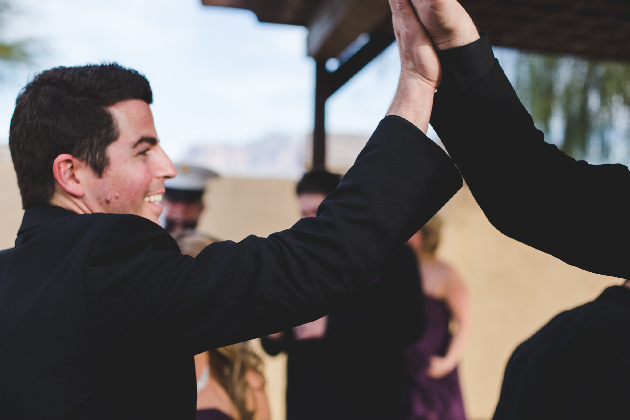 grooms gives high five after ceremony mj